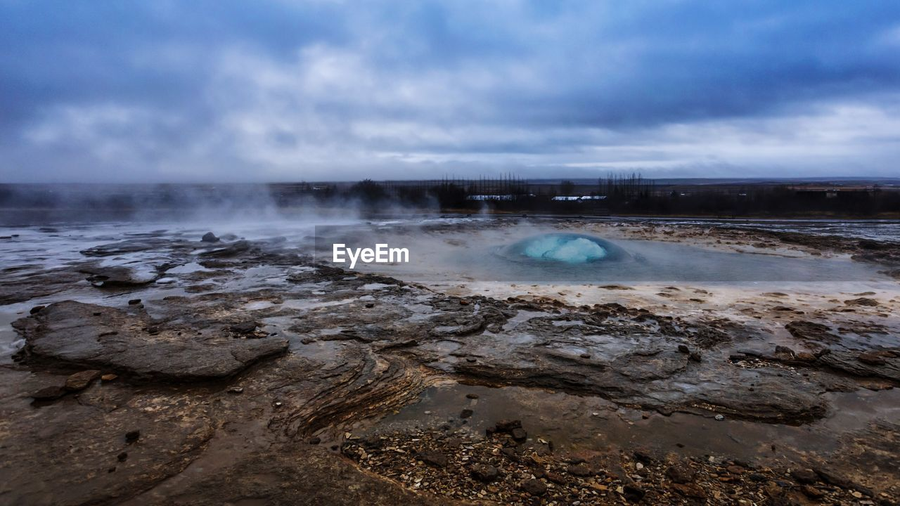 water, sky, beauty in nature, scenics - nature, cloud - sky, power in nature, steam, nature, geology, no people, tranquil scene, geyser, non-urban scene, heat - temperature, smoke - physical structure, tranquility, physical geography, hot spring, land, outdoors