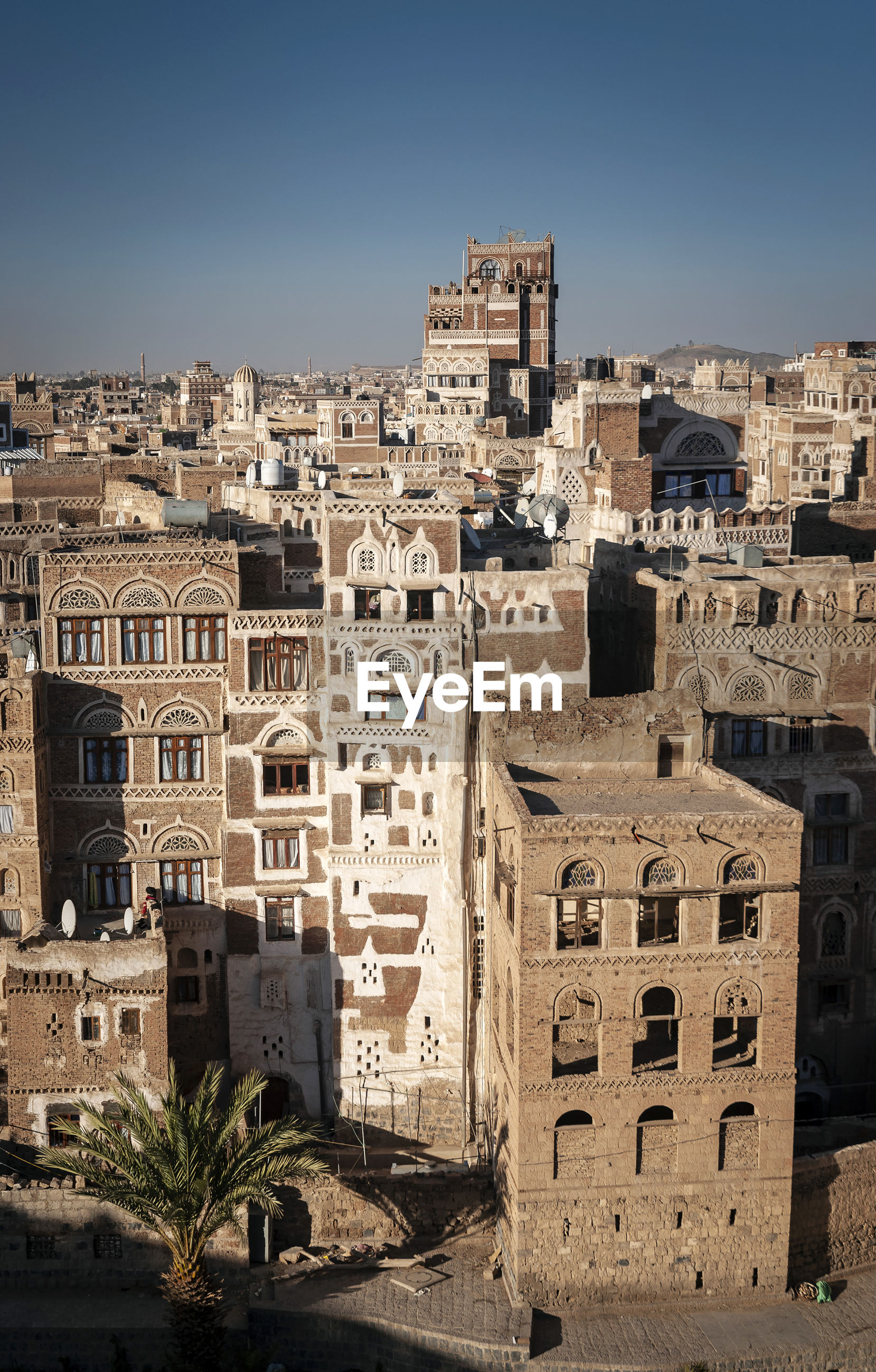 High angle view of old buildings against clear sky in city