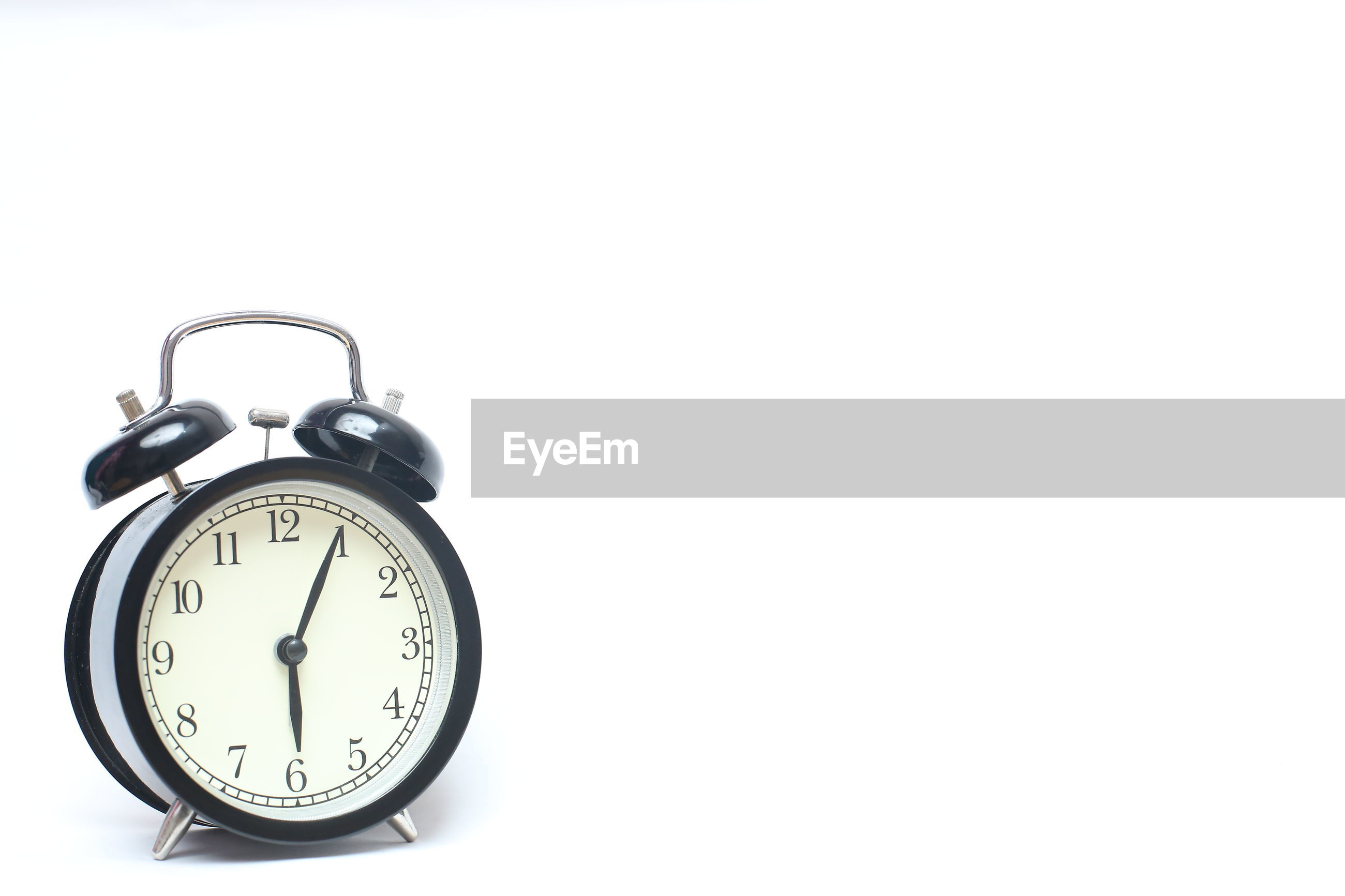 Close-up of alarm clock on white background