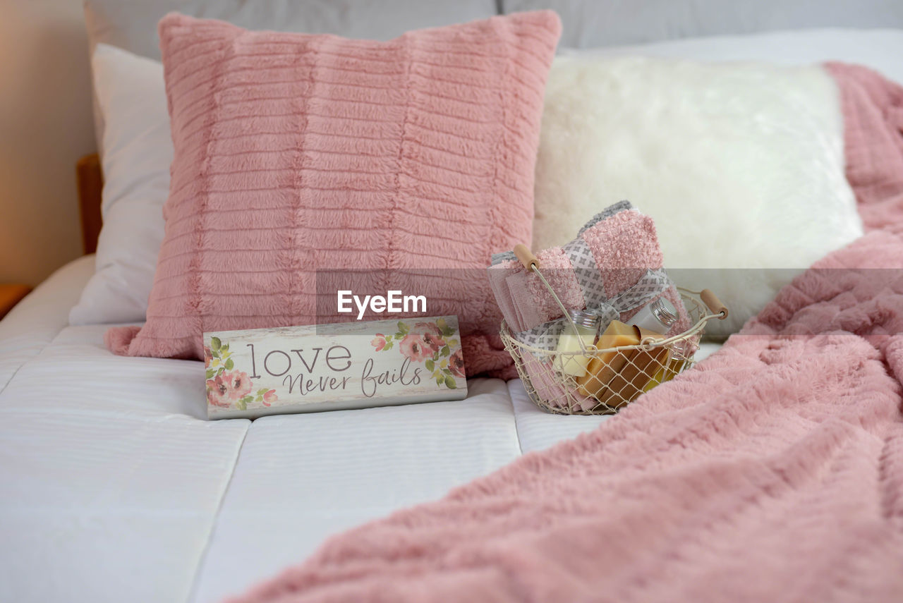indoors, still life, selective focus, close-up, textile, bed, table, furniture, pink color, food, food and drink, no people, freshness, pillow, sweet food, home interior, focus on foreground, unhealthy eating, high angle view, blanket, temptation, tray