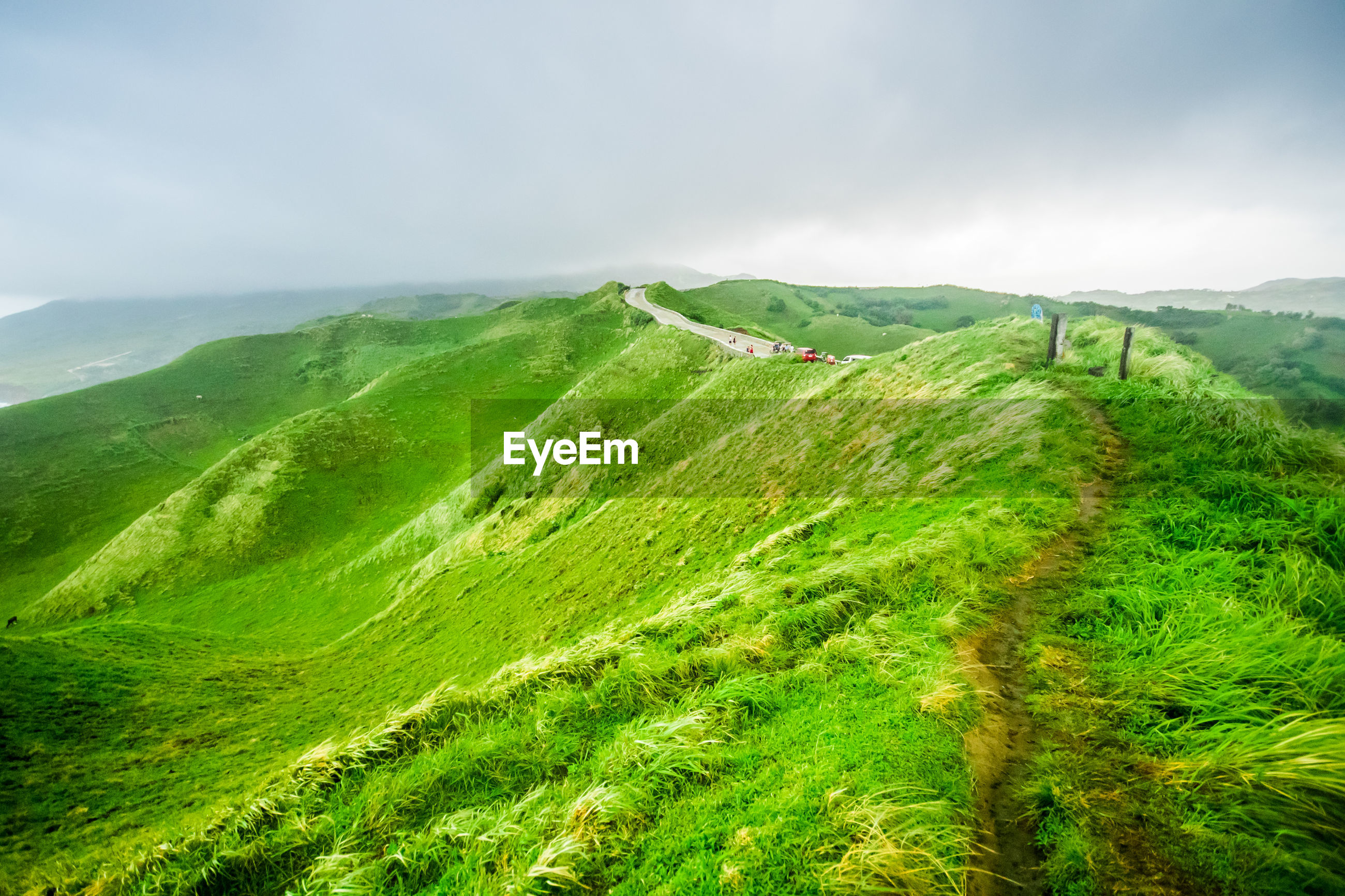 Scenic view of green landscape against sky. rolling hills of iraya, basco, batanes, philippines.