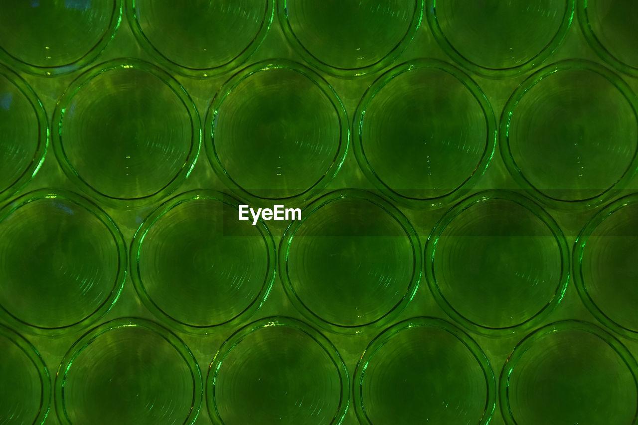 Full frame shot of patterned green glass wall