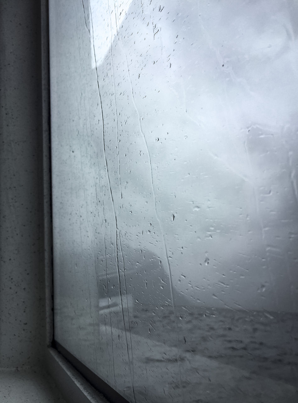 glass - material, wet, drop, transparent, window, water, rain, indoors, no people, close-up, nature, day, glass, full frame, raindrop, focus on foreground, rainy season