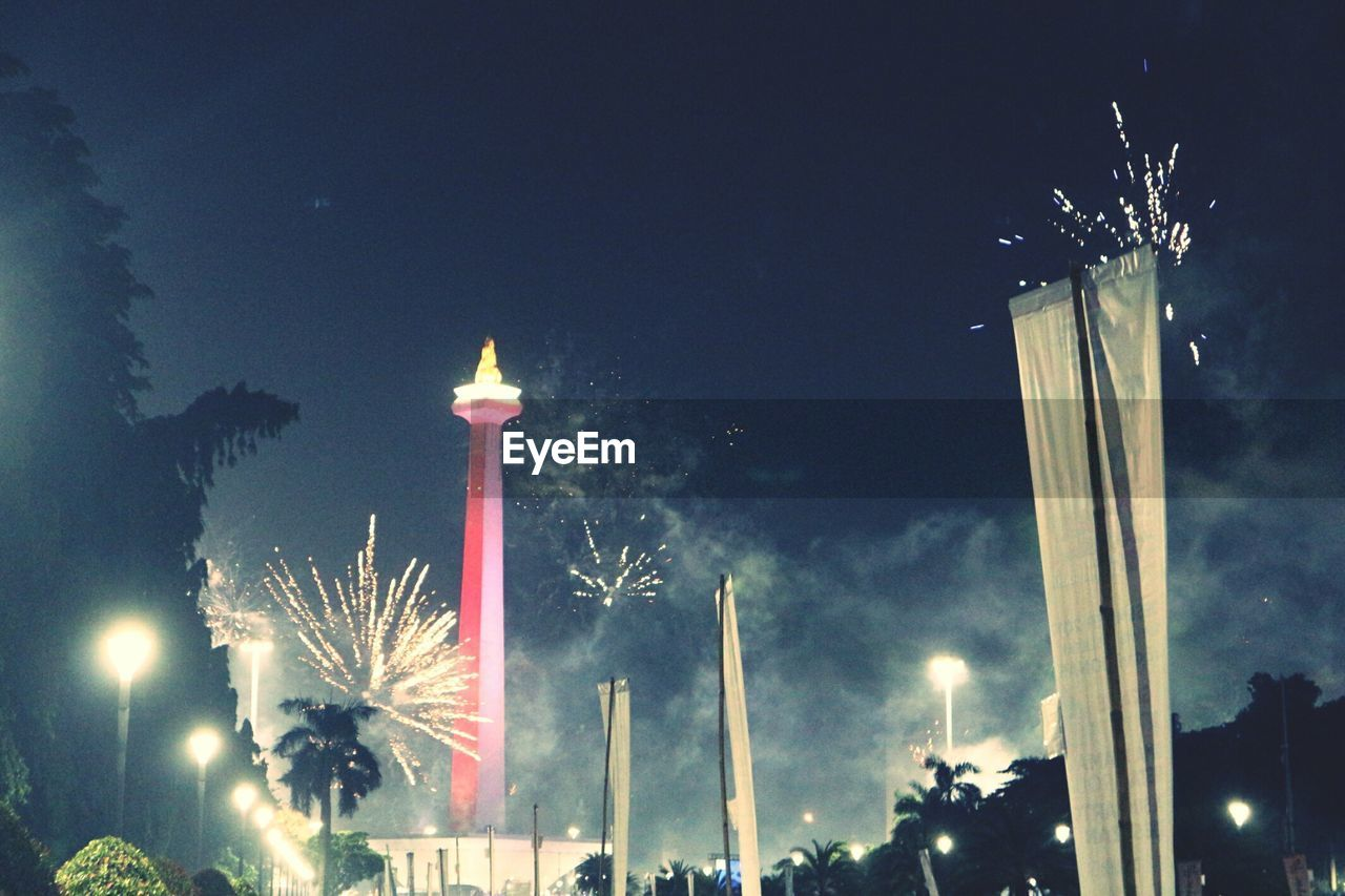 night, illuminated, celebration, built structure, low angle view, outdoors, architecture, sky, firework, no people, tree