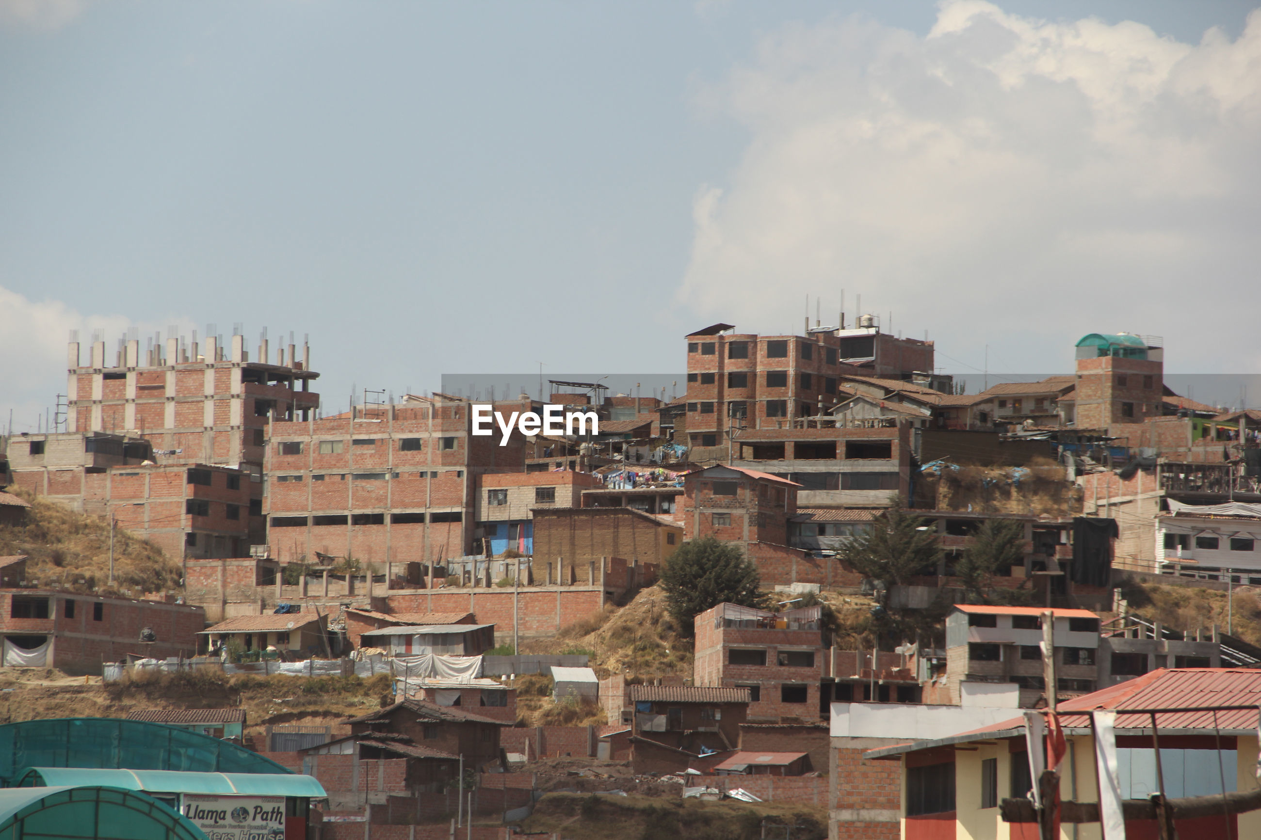 High angle view of buildings in town against sky