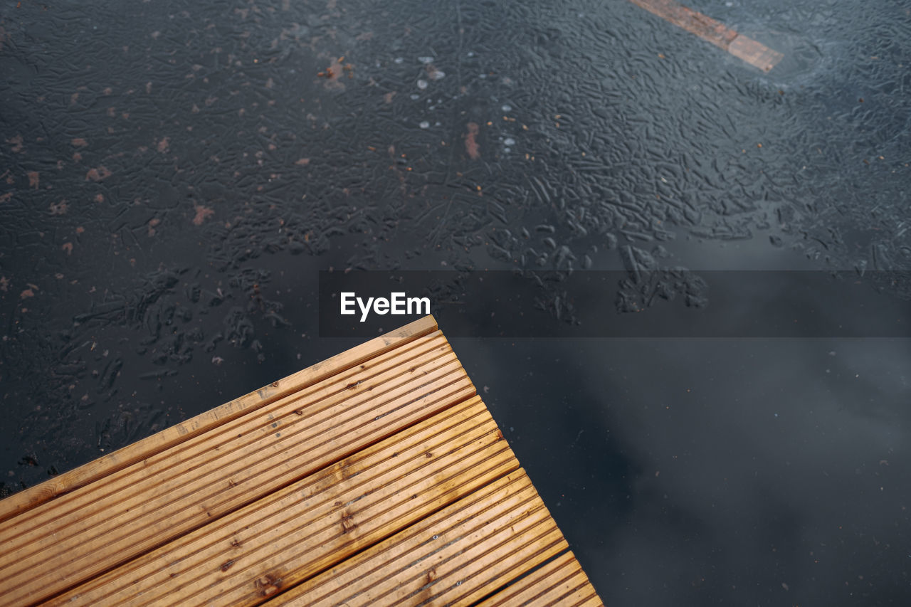 HIGH ANGLE VIEW OF WET WINDOW DURING WINTER