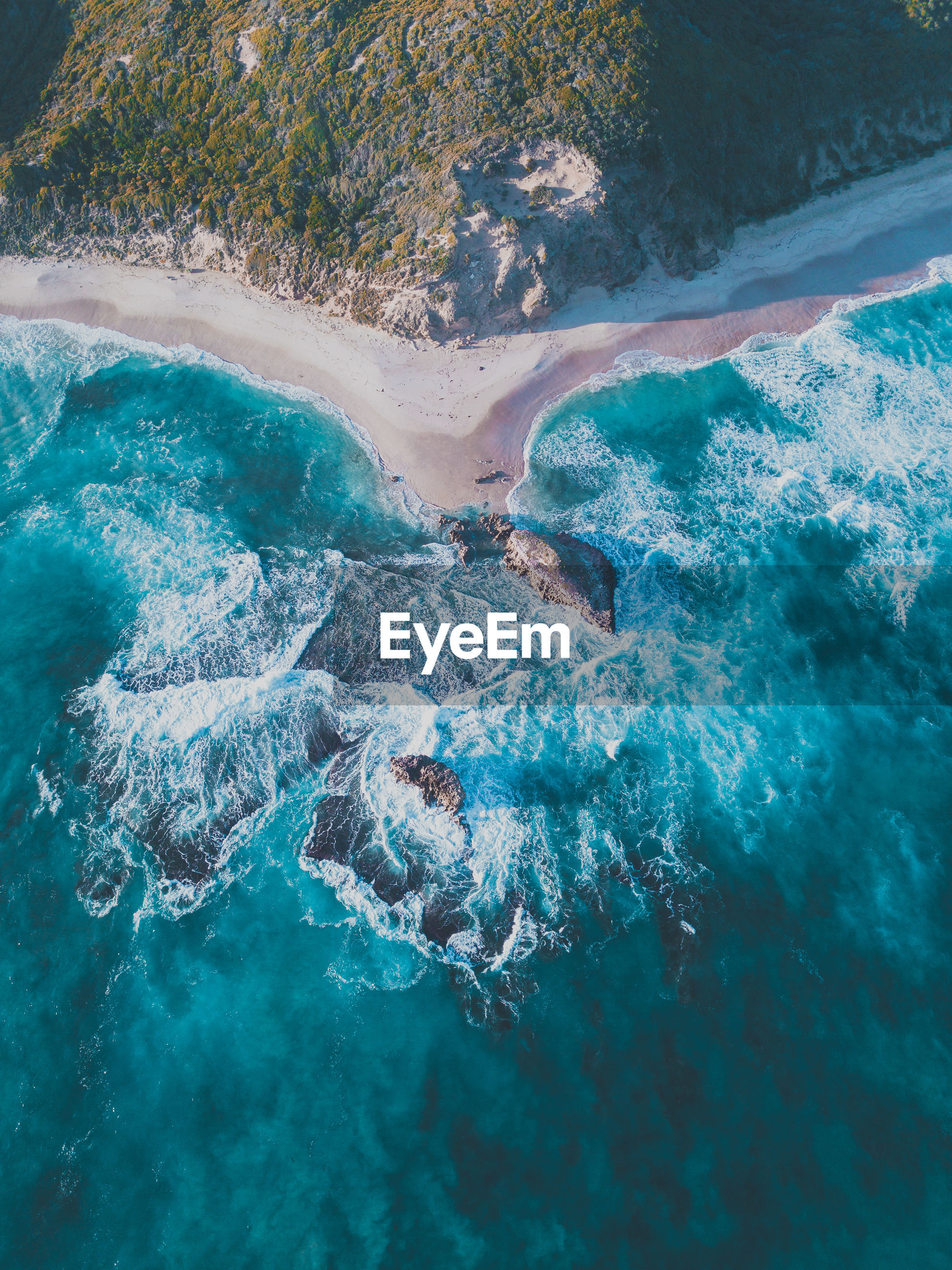 AERIAL VIEW OF BLUE SEA AND ROCKS