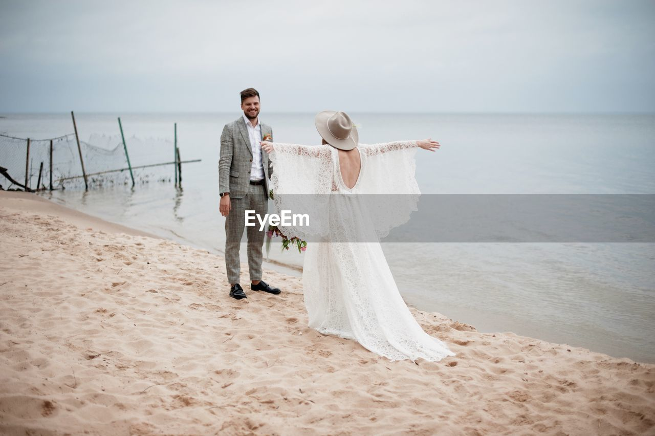 Bride And Bridegroom At Beach During Wedding Ceremony