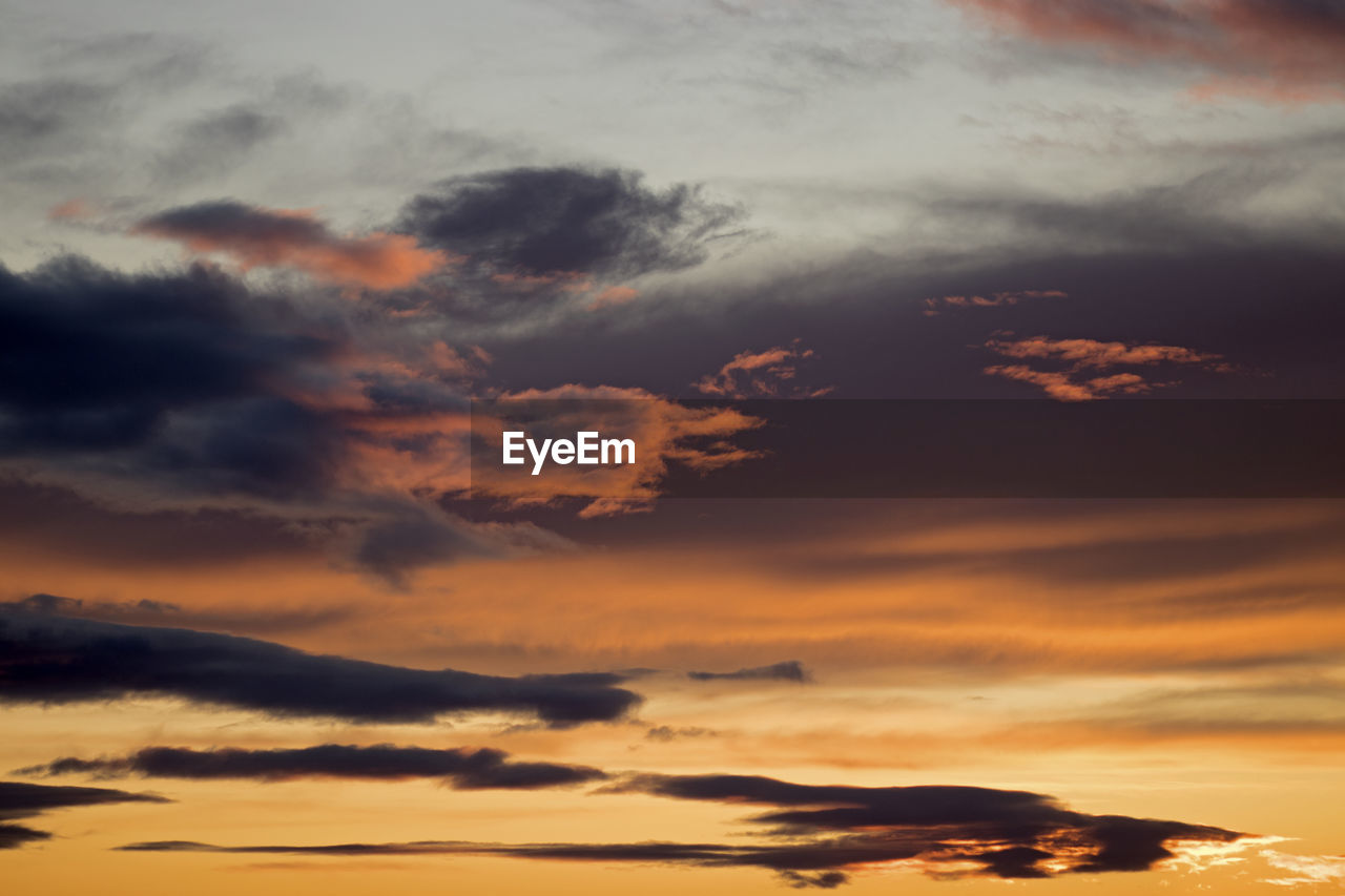 cloud - sky, sky, beauty in nature, tranquility, scenics - nature, sunset, no people, tranquil scene, nature, idyllic, orange color, low angle view, outdoors, full frame, dramatic sky, backgrounds, non-urban scene, overcast, cloudscape, meteorology
