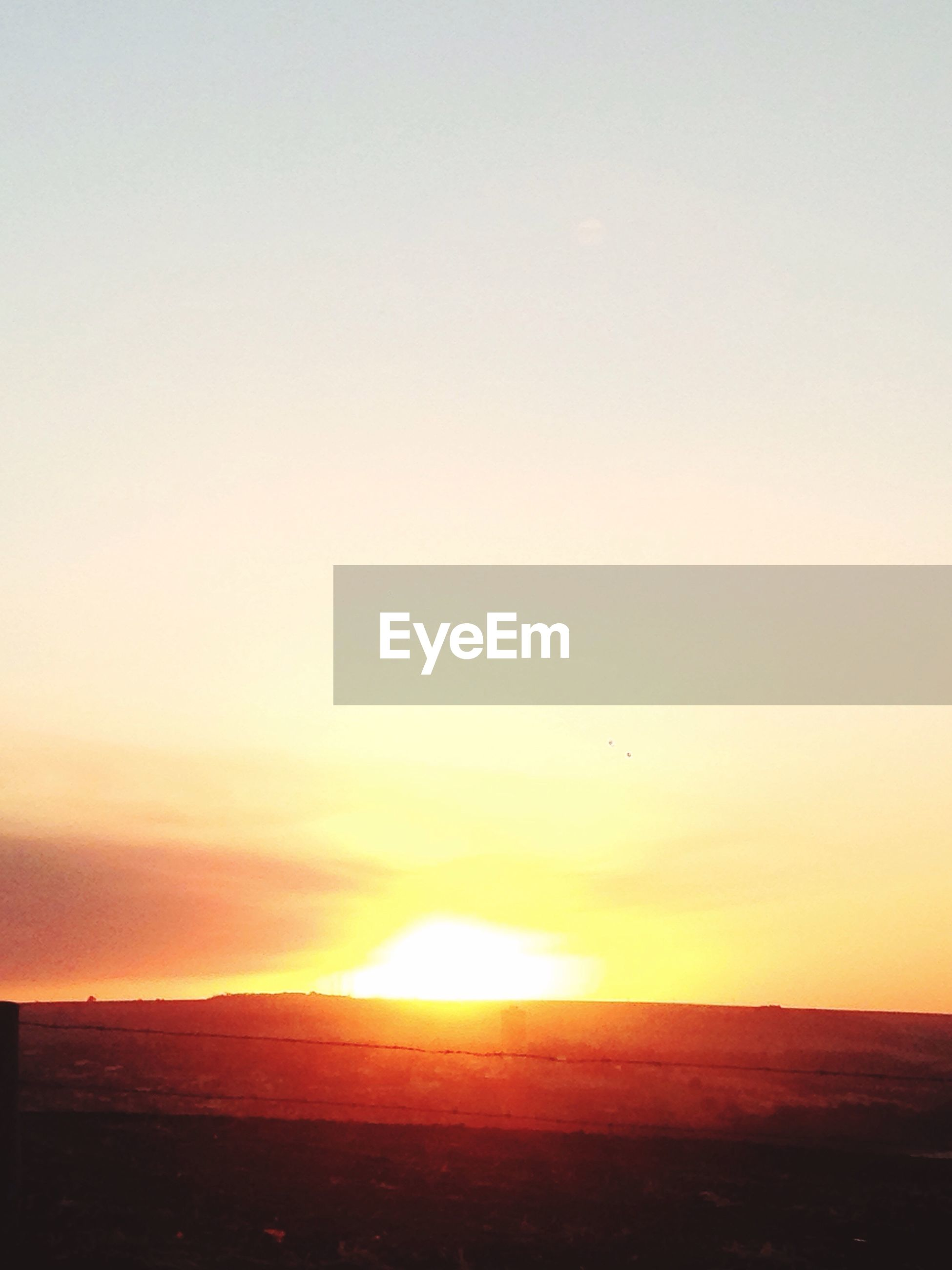 sunset, sun, landscape, scenics, tranquil scene, orange color, beauty in nature, tranquility, idyllic, nature, sky, field, romantic sky, mountain, outdoors, horizon over land, vibrant color, remote, moody sky, majestic, no people, bright, rural scene, atmosphere, dramatic sky, non-urban scene