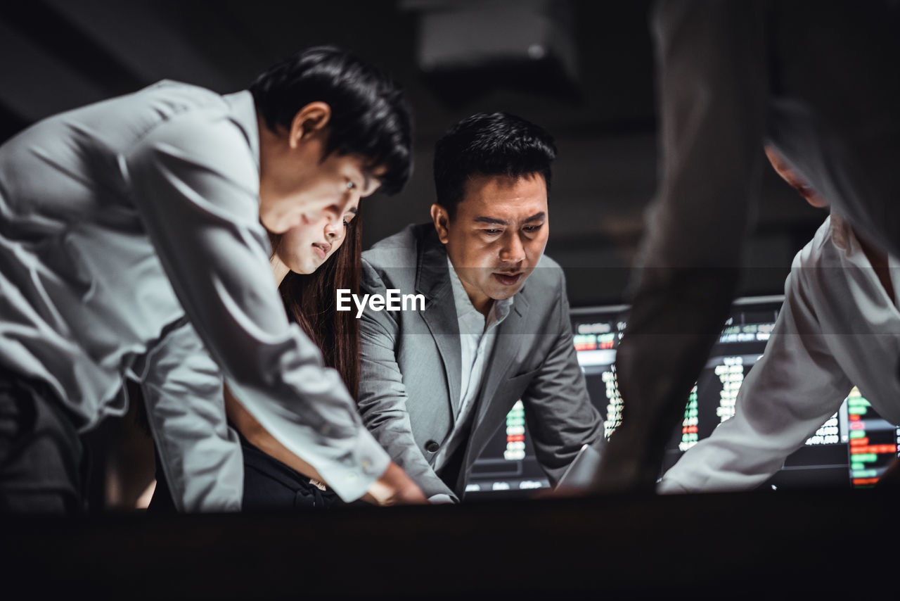 Low angle view of business people discussing in office