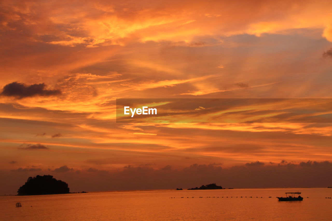 sky, sunset, cloud - sky, scenics - nature, orange color, beauty in nature, water, sea, transportation, nautical vessel, mode of transportation, tranquility, tranquil scene, waterfront, nature, idyllic, no people, silhouette, outdoors, horizon over water, romantic sky