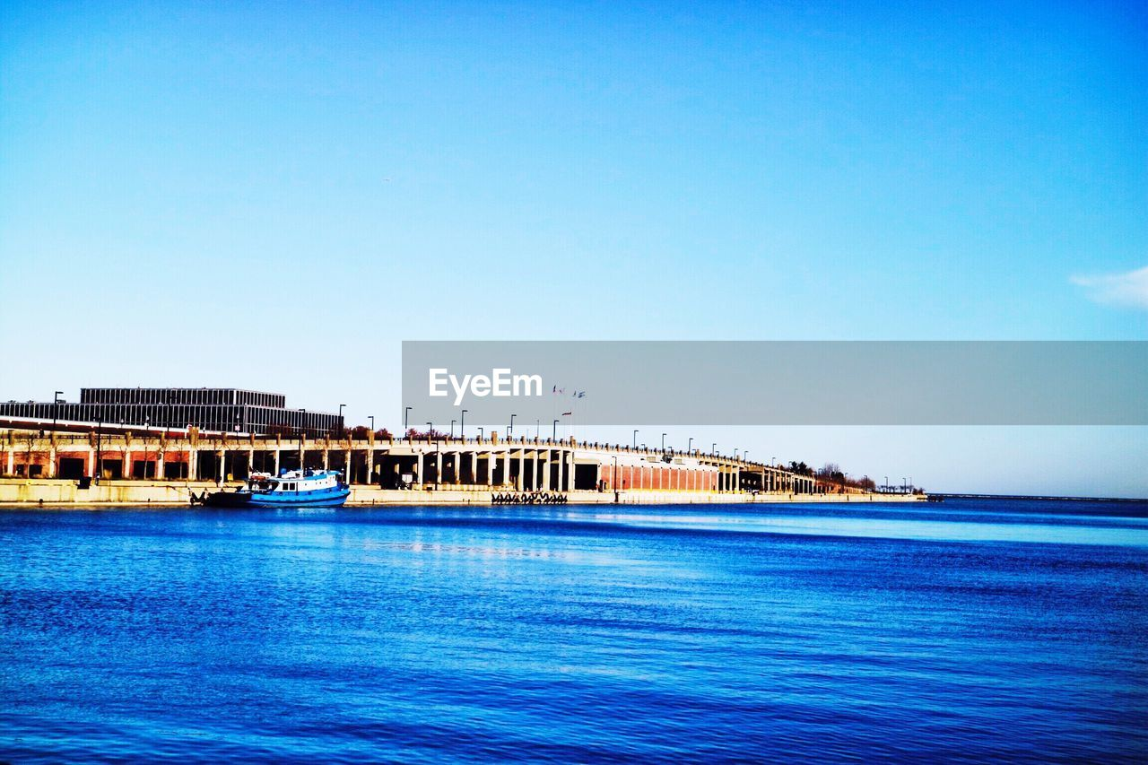 blue, sea, built structure, clear sky, water, architecture, transportation, outdoors, nautical vessel, day, nature, sky, no people, building exterior, scenics, beauty in nature