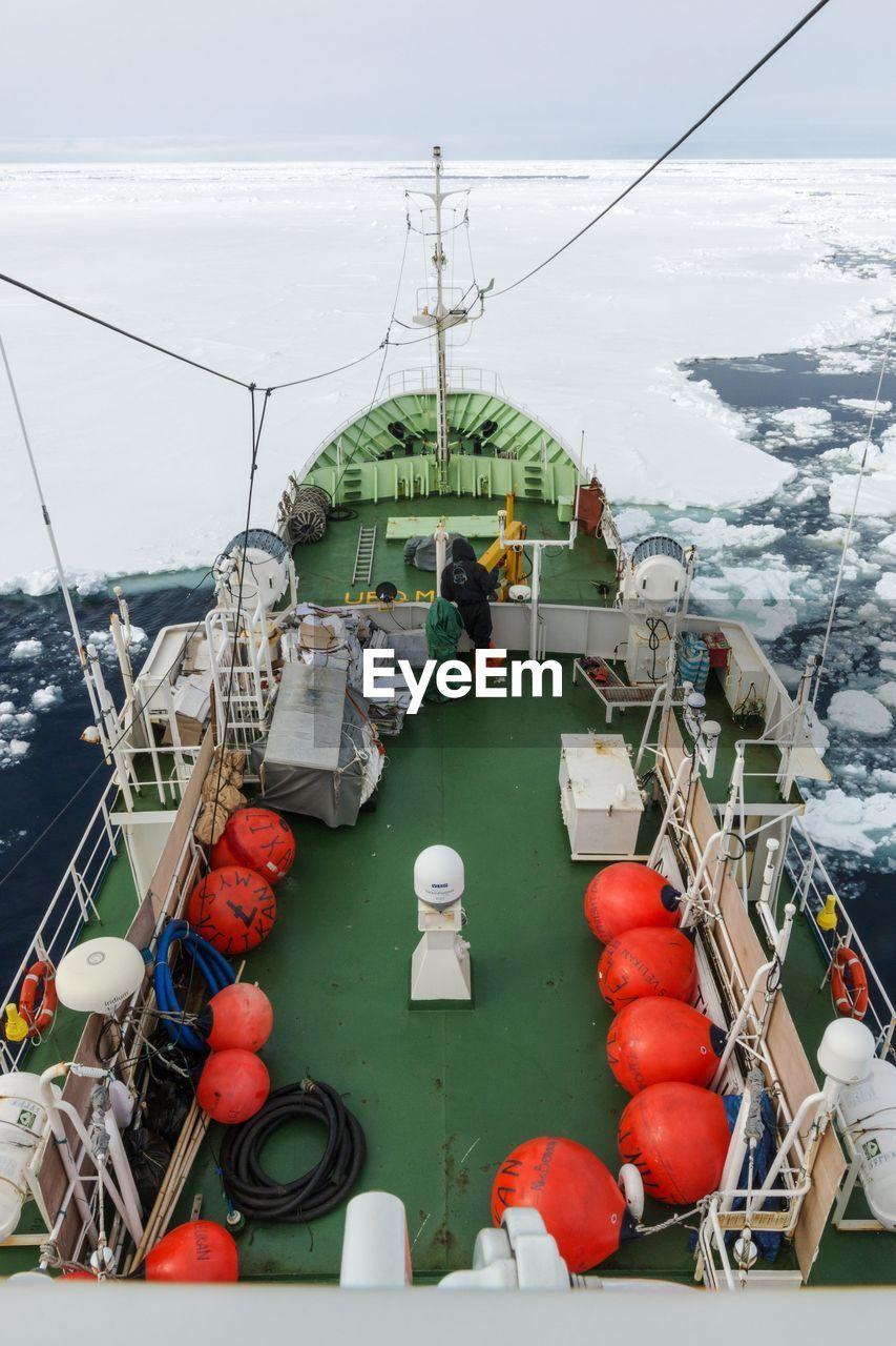 High angle view of boat moored in frozen sea