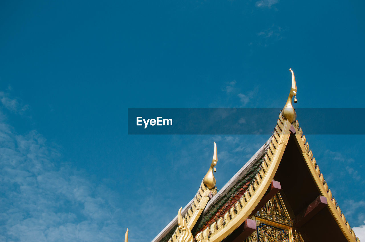 Low angle view of temple building against blue sky