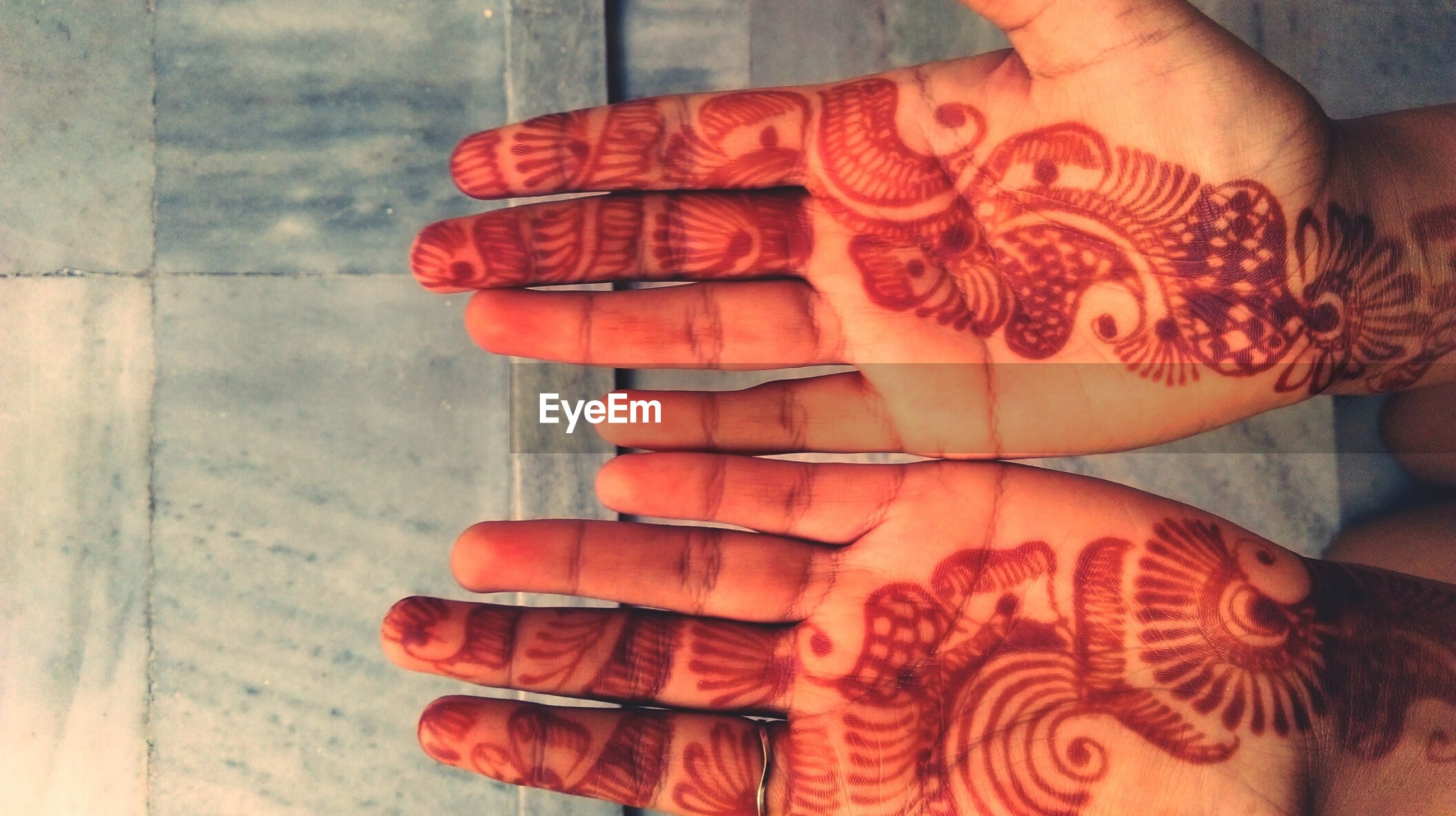 Cropped image of person showing henna tattoo