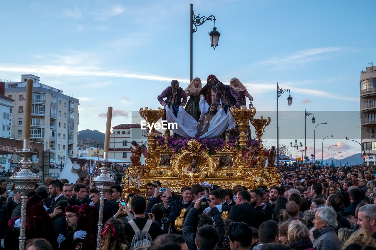 crowd, group of people, large group of people, real people, architecture, men, building exterior, built structure, women, city, sky, lifestyles, adult, representation, leisure activity, street, celebration, human representation, nature