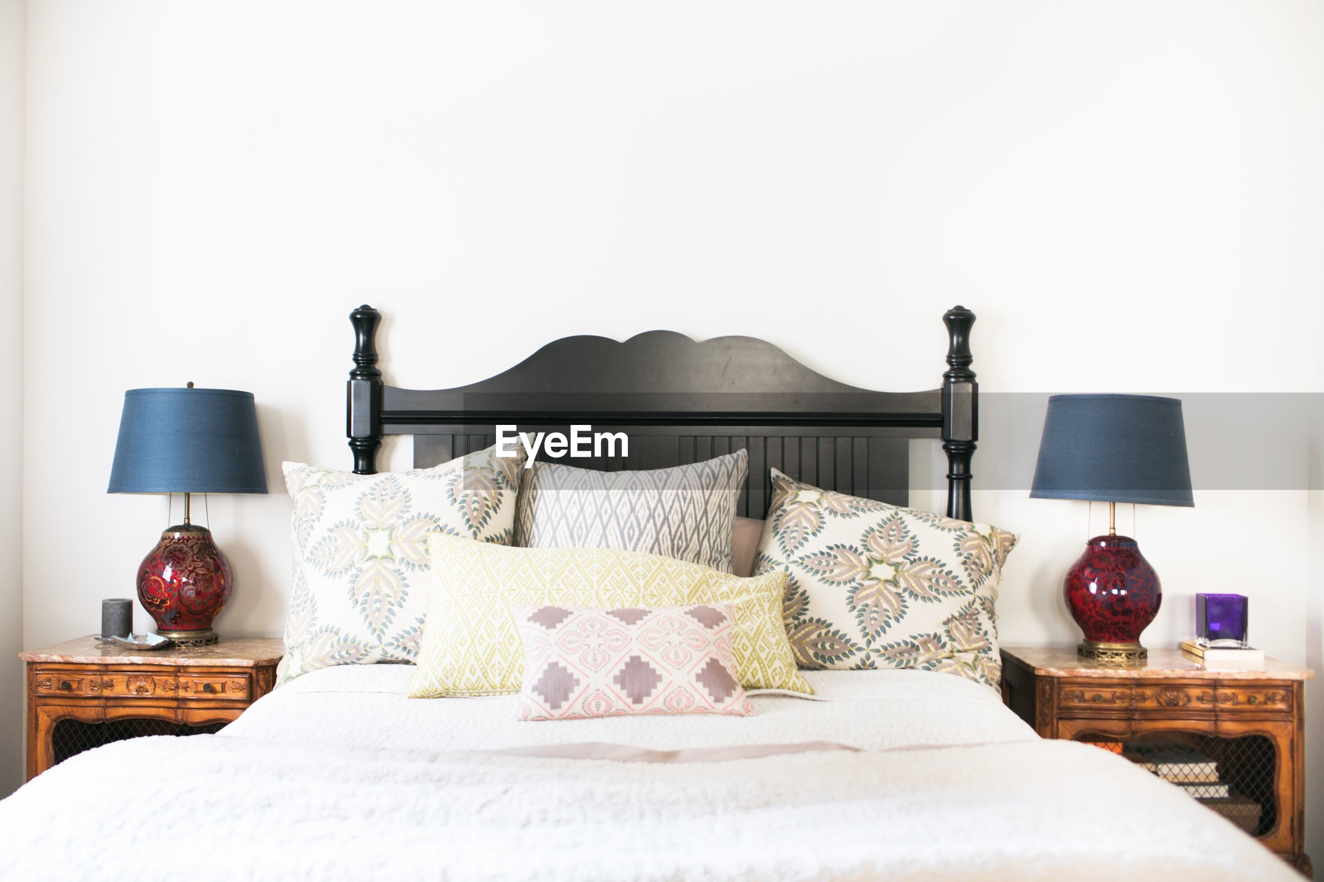 ELECTRIC LAMP ON BED AGAINST WALL