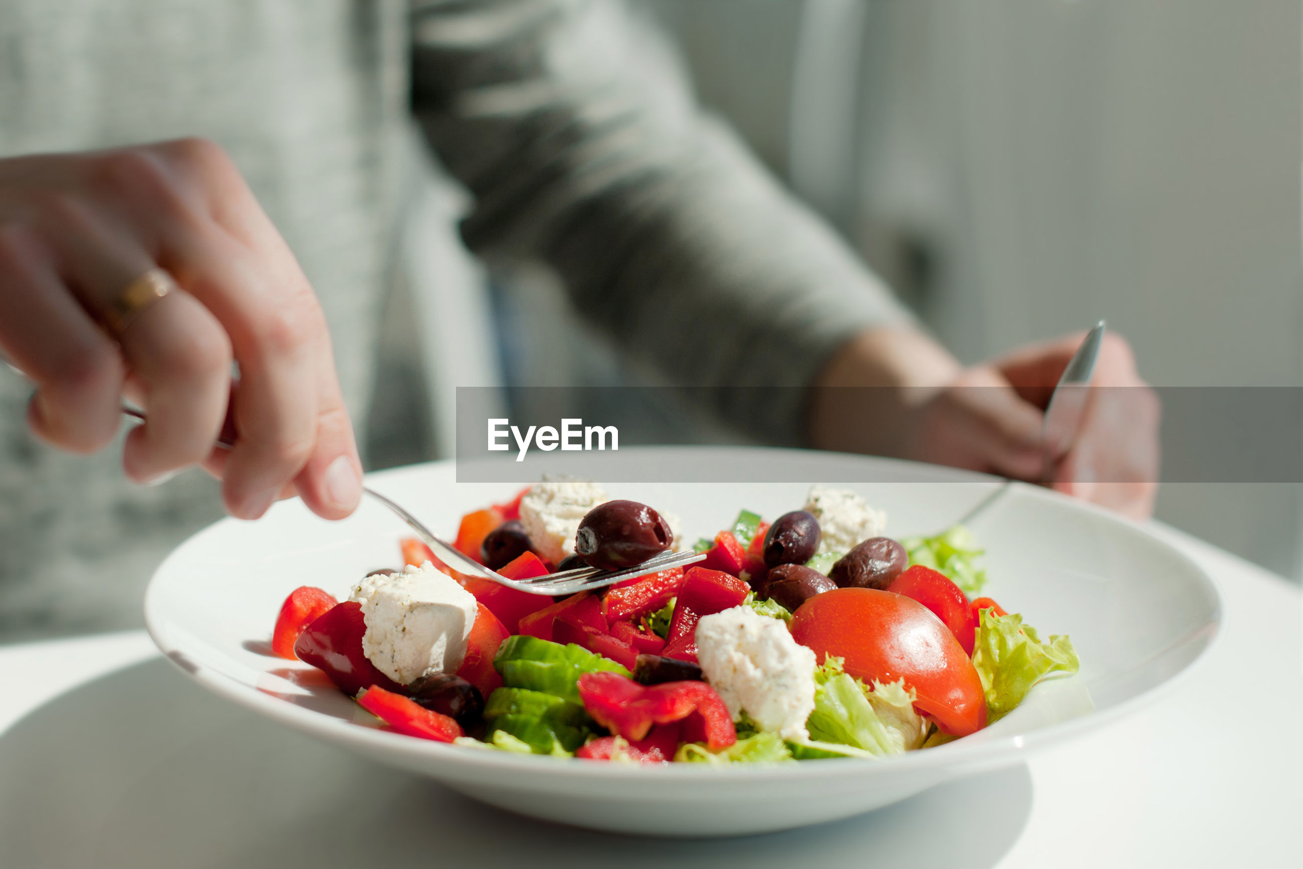 Close-up of person having food at table