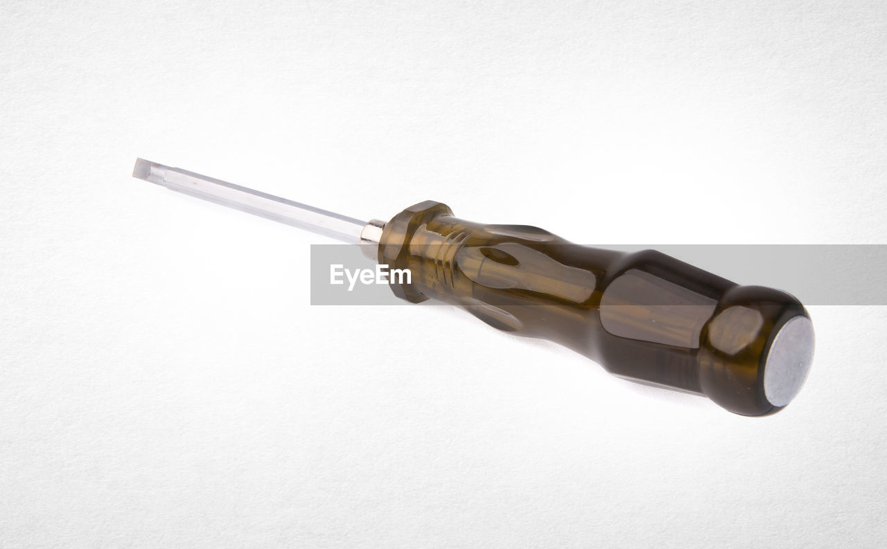 Close-up of screw driver against white background