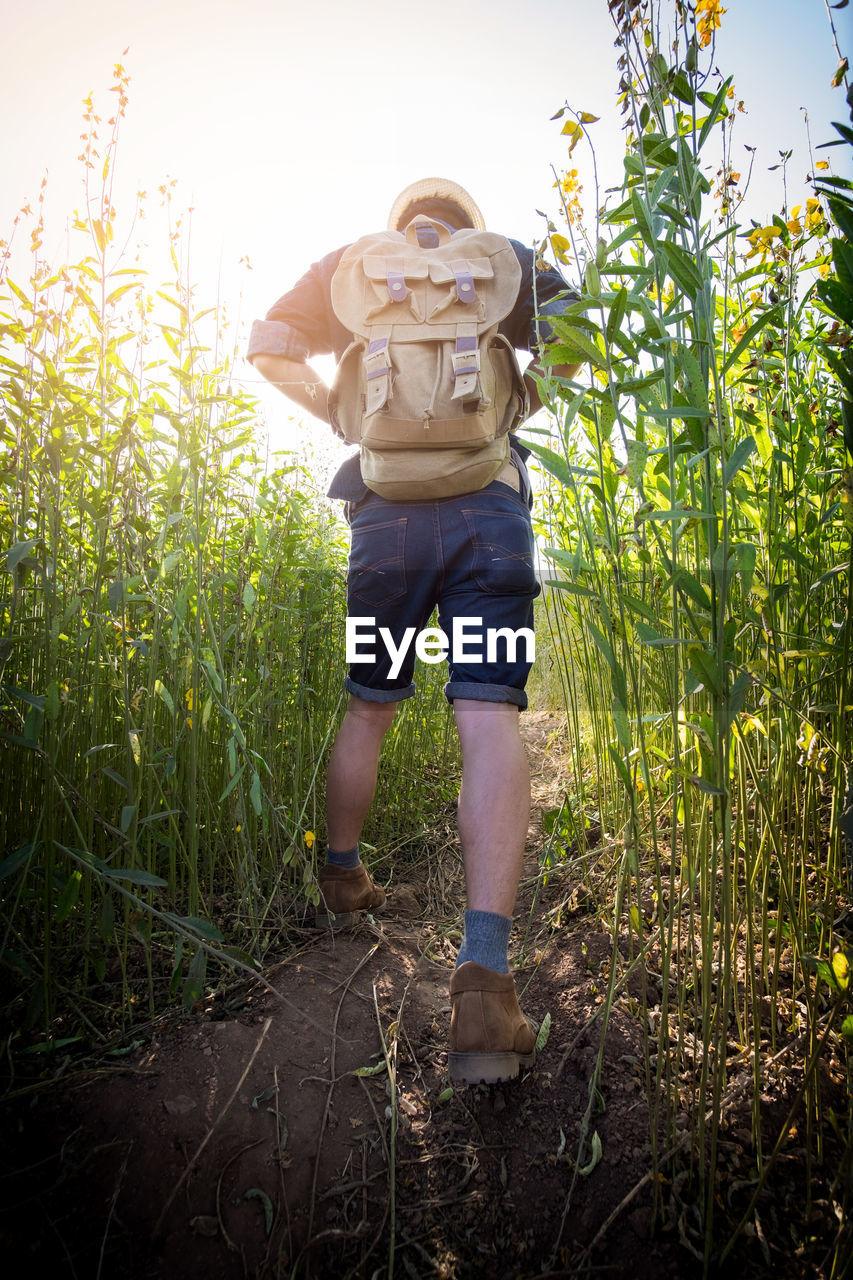 Full Length Of Man Walking On Field In Farm