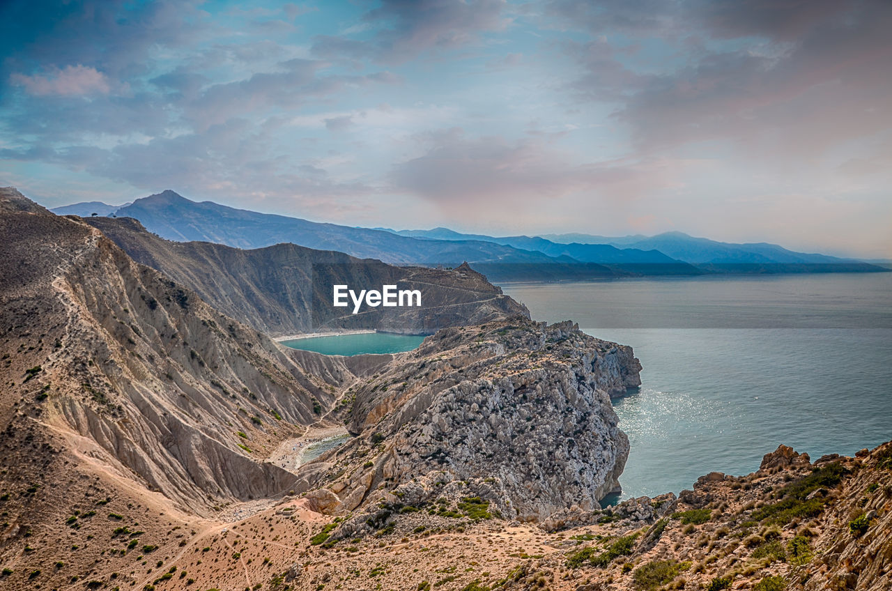 beauty in nature, scenics - nature, mountain, sky, tranquil scene, tranquility, cloud - sky, mountain range, non-urban scene, water, idyllic, nature, no people, sea, physical geography, landscape, day, environment, remote, outdoors, formation, volcanic crater