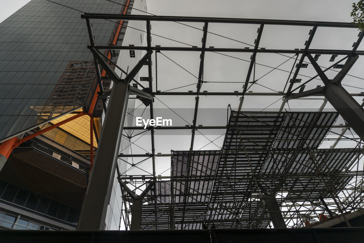built structure, architecture, low angle view, building exterior, no people, building, day, outdoors, nature, metal, city, construction industry, modern, construction site, sky, industry, pattern, glass - material, development, office