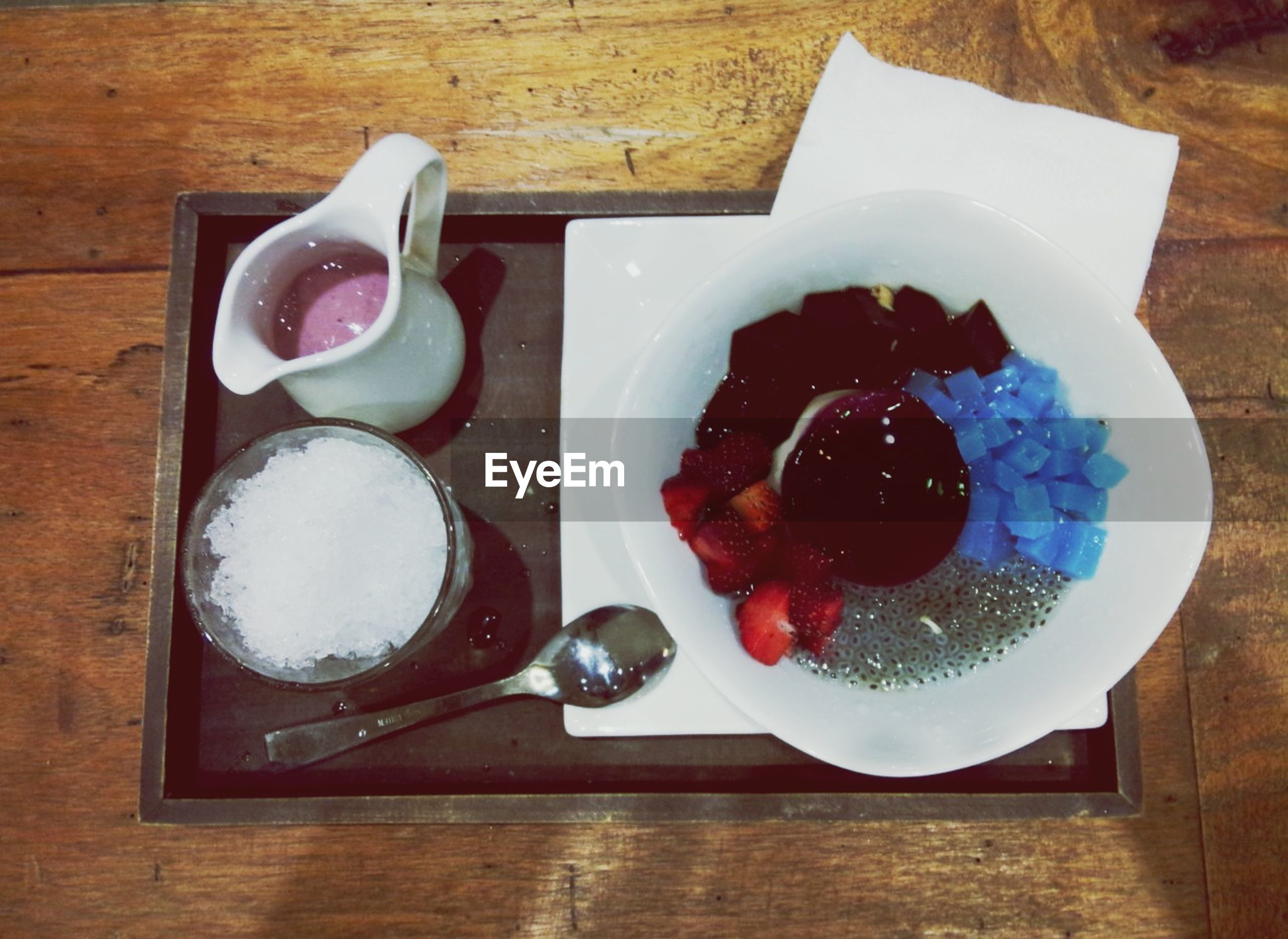 food and drink, indoors, table, freshness, food, still life, plate, high angle view, sweet food, ready-to-eat, dessert, indulgence, directly above, fruit, healthy eating, fork, spoon, serving size, cake, wood - material
