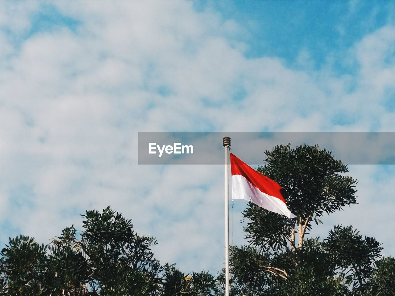 Low Angle View Of Indonesian Flag Against Sky