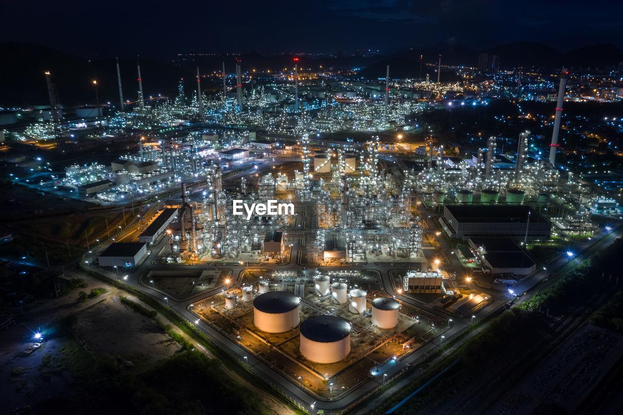 High angle view refinery of illuminated city at night