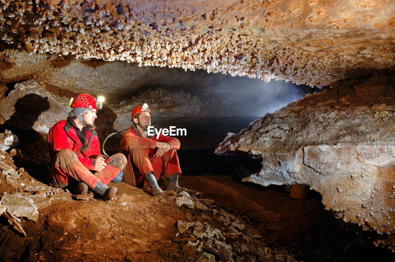 Workers Sitting In Cave