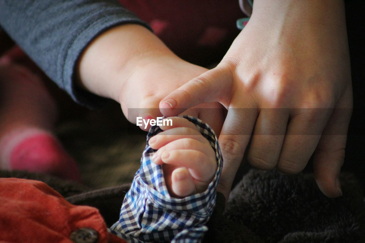 Close-Of Children And Baby's Hands