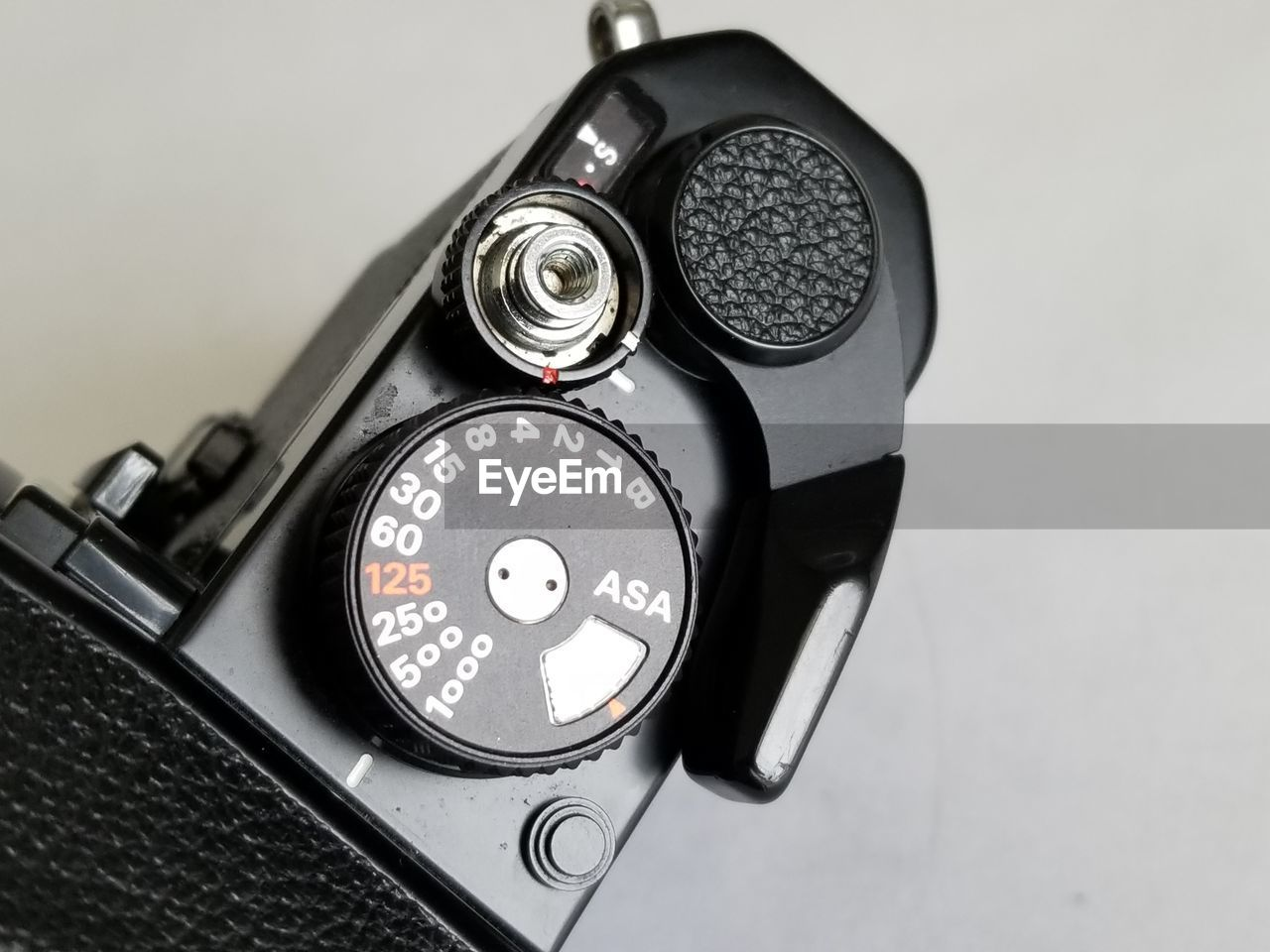 close-up, indoors, technology, photography themes, number, focus on foreground, studio shot, camera - photographic equipment, still life, high angle view, retro styled, no people, black color, photographic equipment, digital camera, metal, camera, communication, lens - optical instrument, silver colored