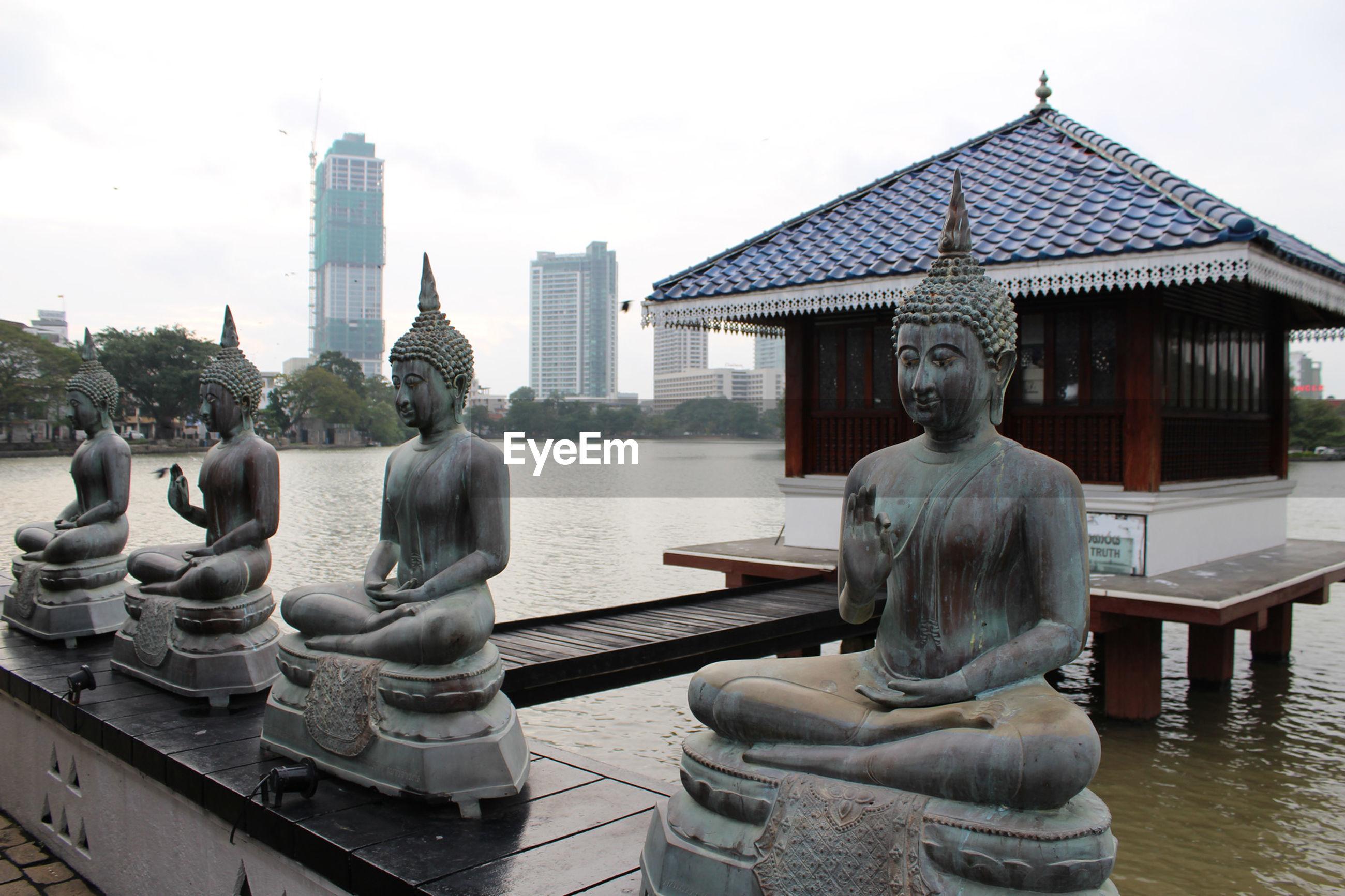 Buddha statues by lake
