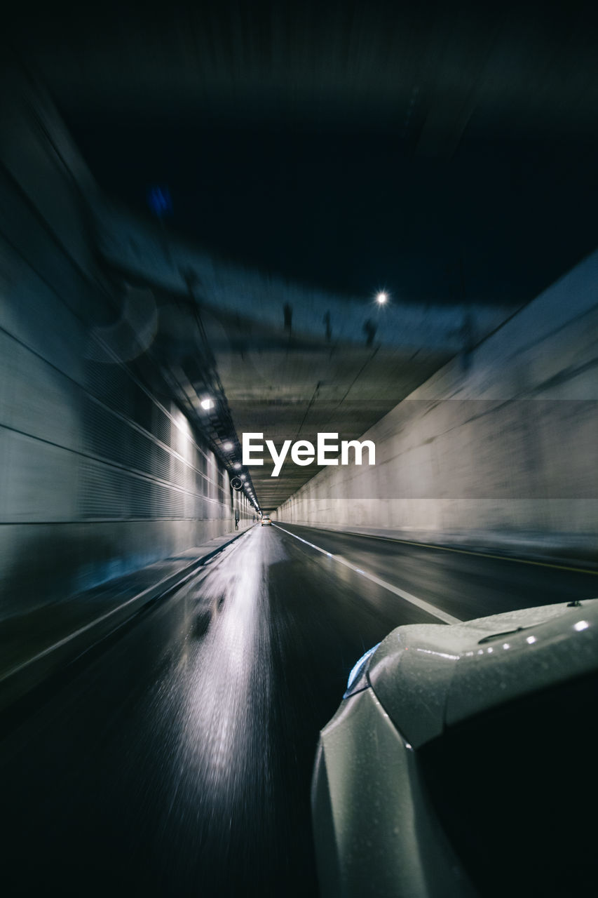 Car Moving On Road In Tunnel