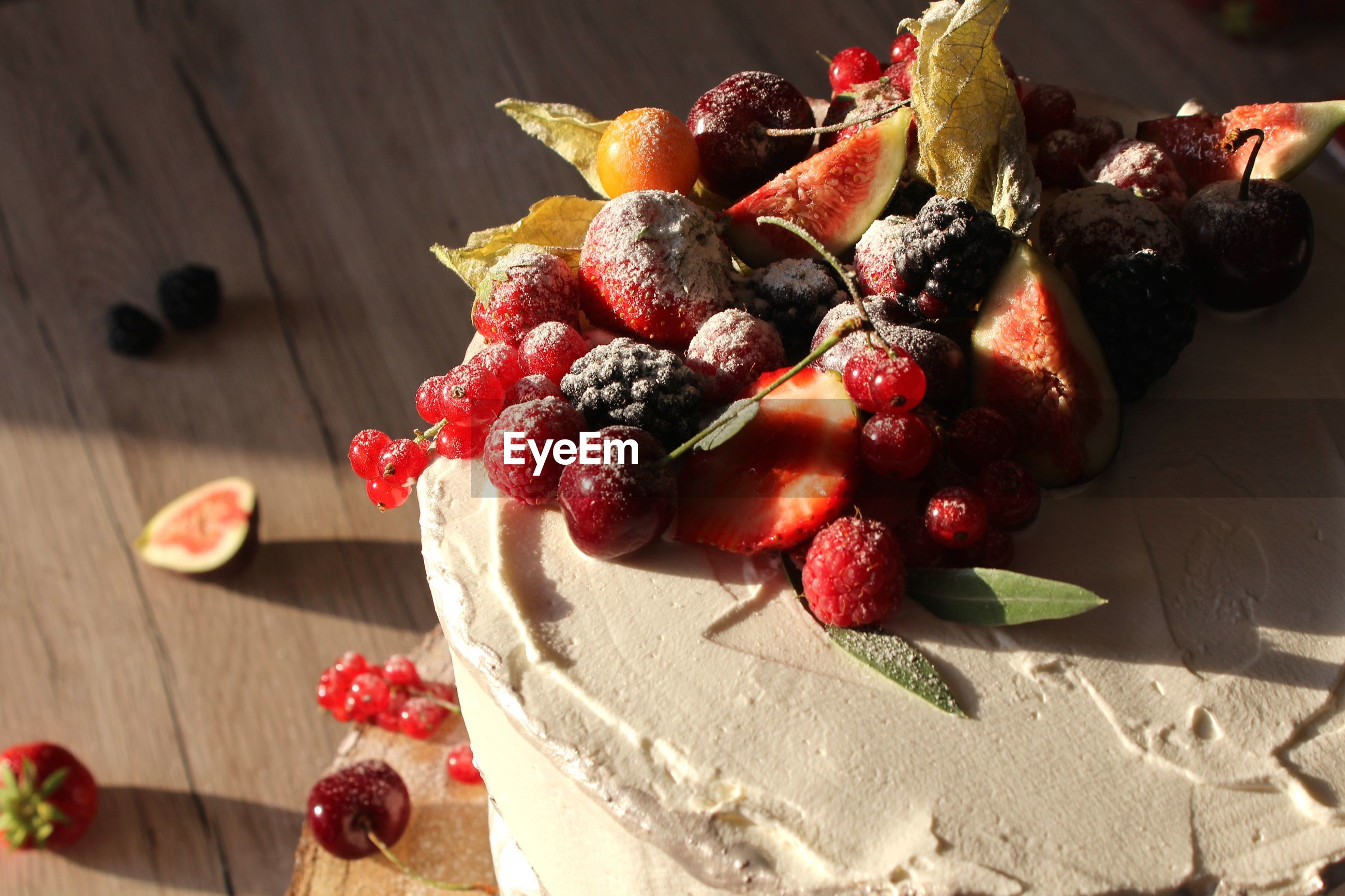 High angle view of cake with fresh fruit on table