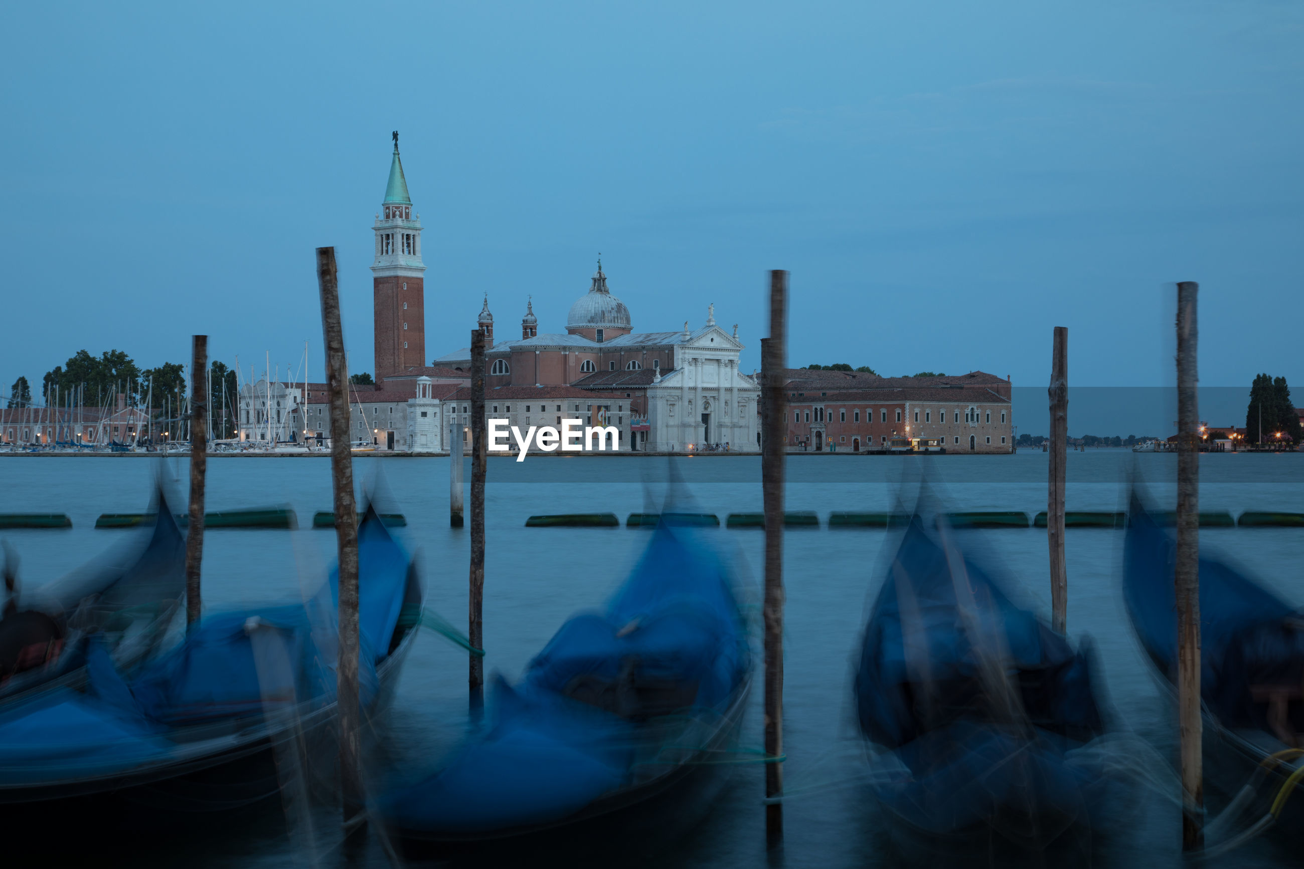 Gondolas on grand canal against sky in city