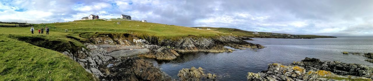 cloud - sky, scenics - nature, beauty in nature, sky, water, tranquil scene, sea, tranquility, non-urban scene, mountain, nature, plant, land, day, panoramic, idyllic, rock, no people, outdoors