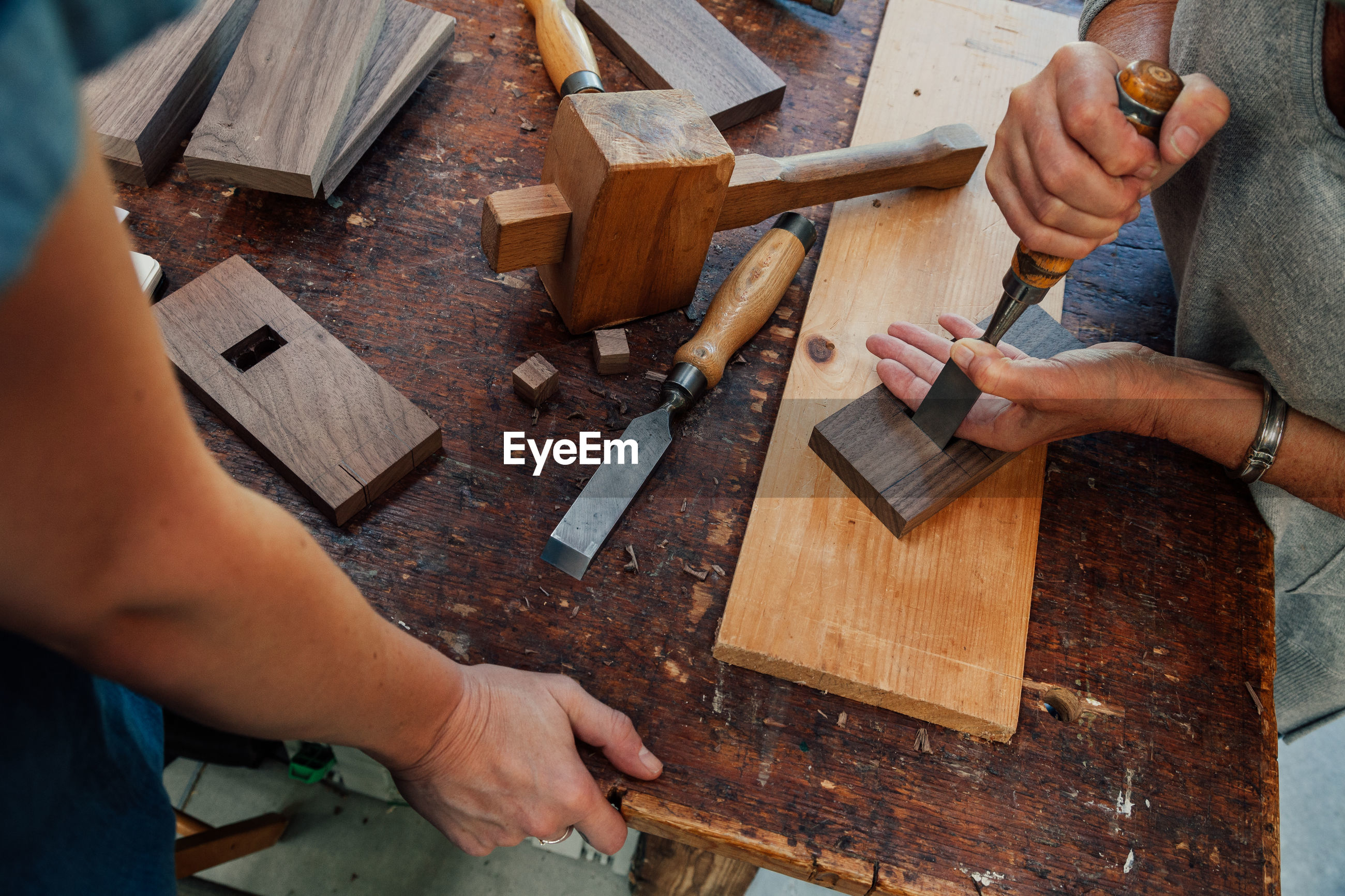 Close-up of carpenters preparing furniture