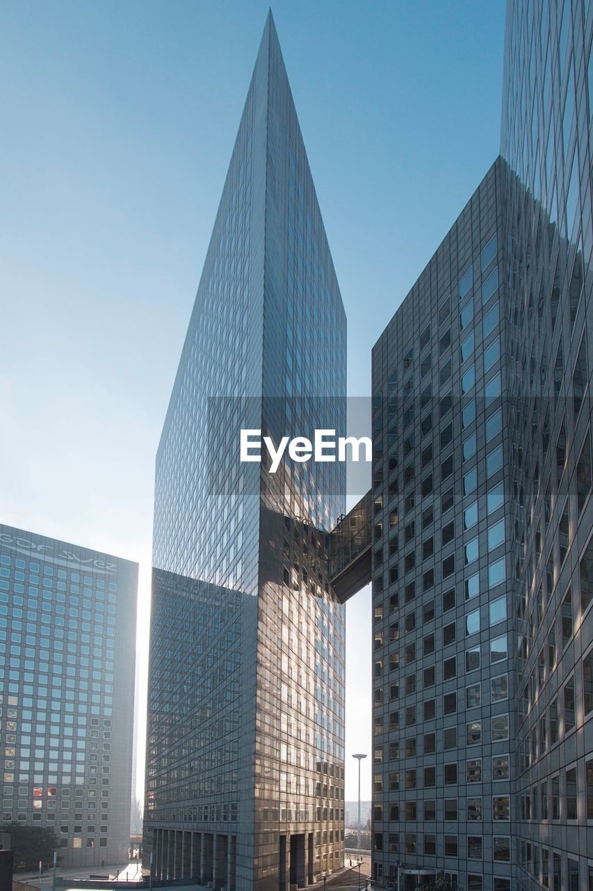 modern, skyscraper, architecture, building exterior, built structure, low angle view, day, no people, city, outdoors, clear sky, blue, sky