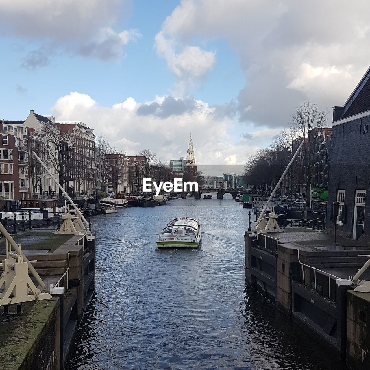 architecture, built structure, building exterior, water, mode of transportation, transportation, cloud - sky, city, sky, nautical vessel, building, nature, canal, residential district, day, no people, waterfront, outdoors, passenger craft, cityscape