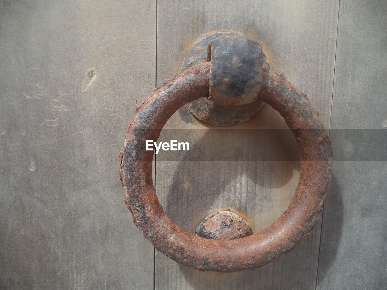 metal, rusty, close-up, shape, door, door knocker, no people, circle, jewelry, hanging, ring, geometric shape, entrance, old, day, safety, wall - building feature, security, protection, wood - material, outdoors