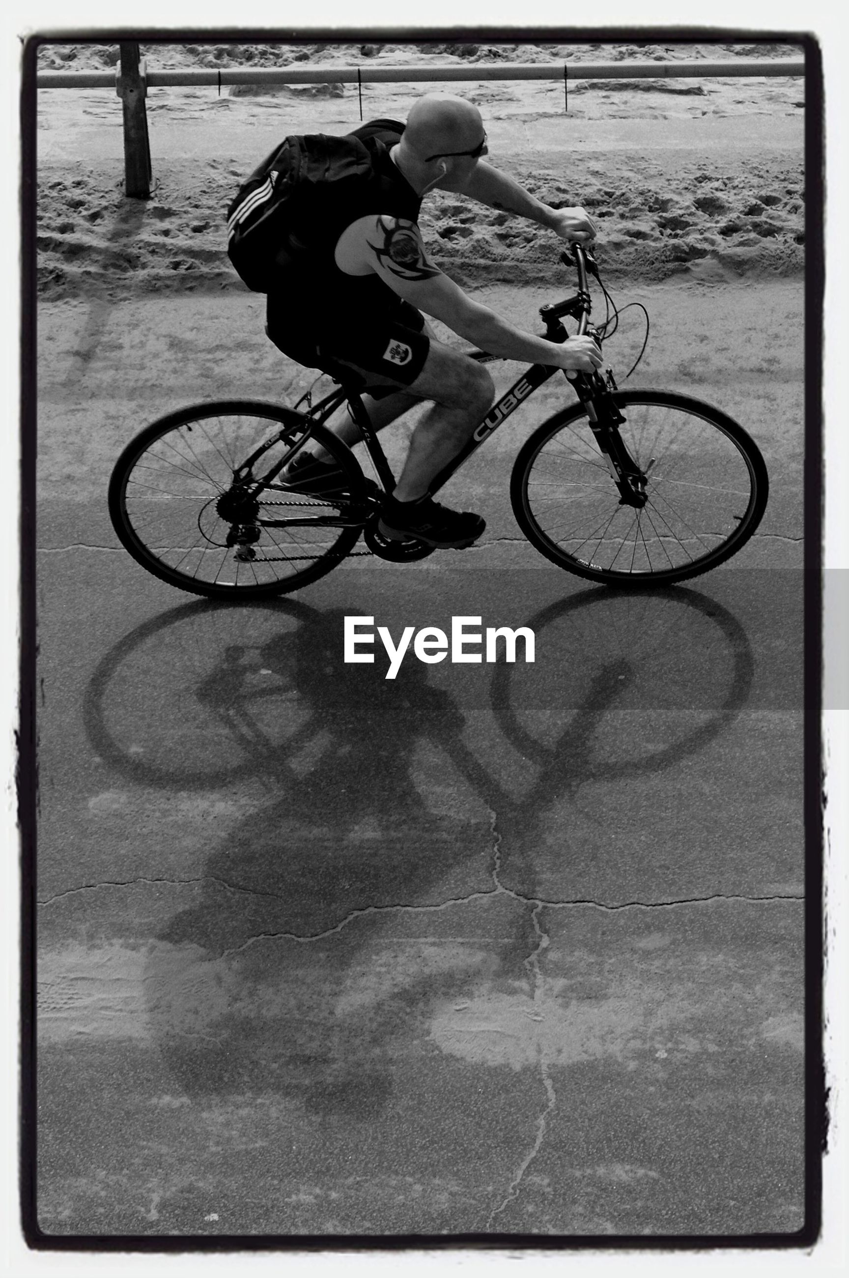 bicycle, transportation, mode of transport, land vehicle, transfer print, auto post production filter, street, stationary, parking, shadow, high angle view, parked, sunlight, cycling, day, road, riding, outdoors, sidewalk, absence