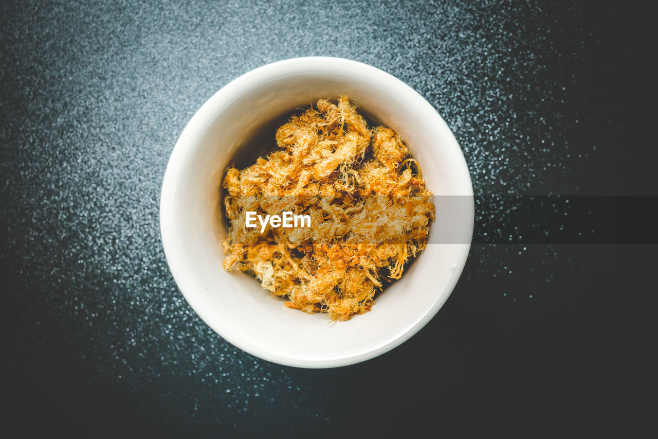 High Angle View Of Food In Bowl Over Black Background