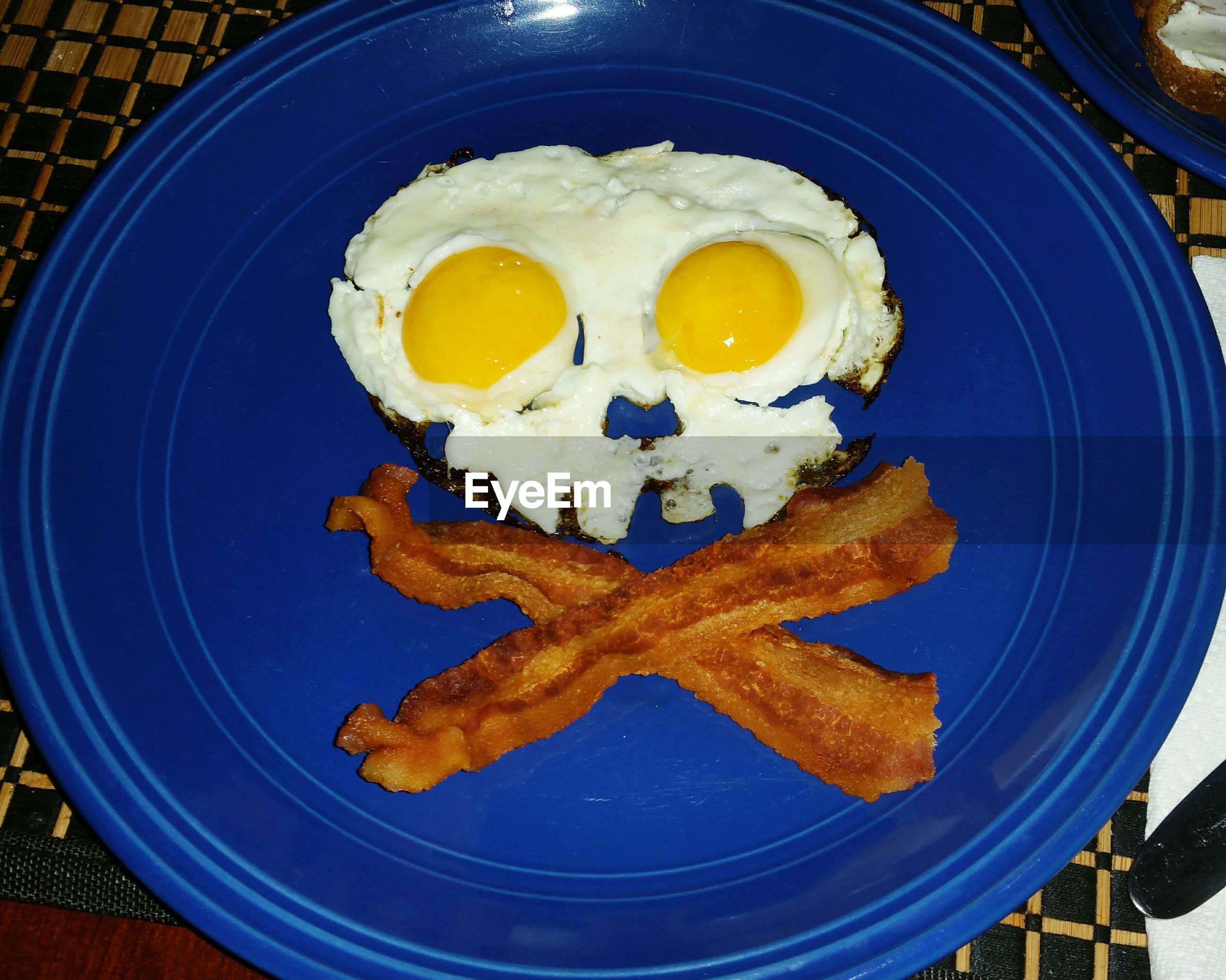 Eggs and bacon shaped as skull