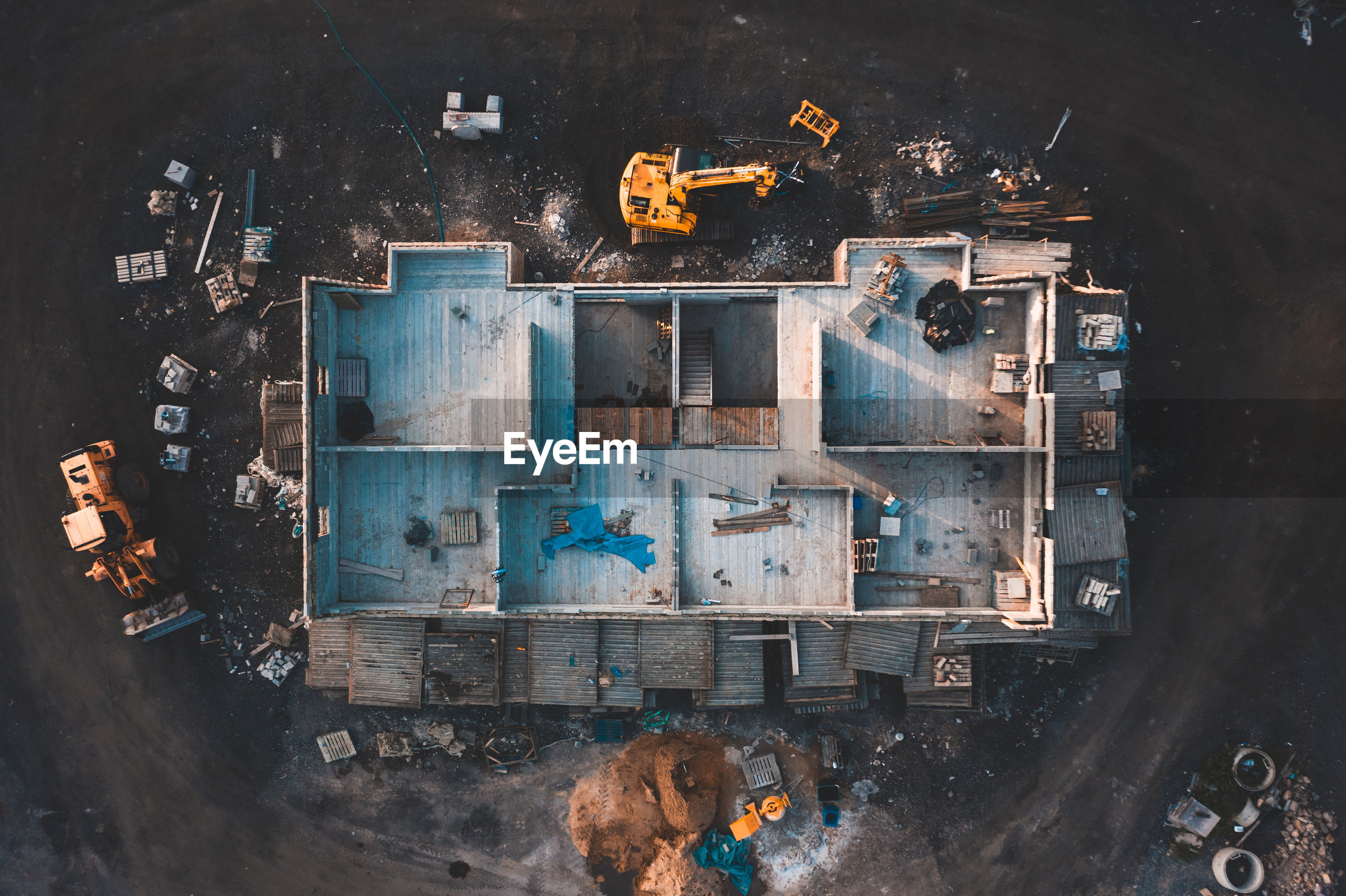 HIGH ANGLE VIEW OF OLD MACHINE IN ABANDONED BUILDING
