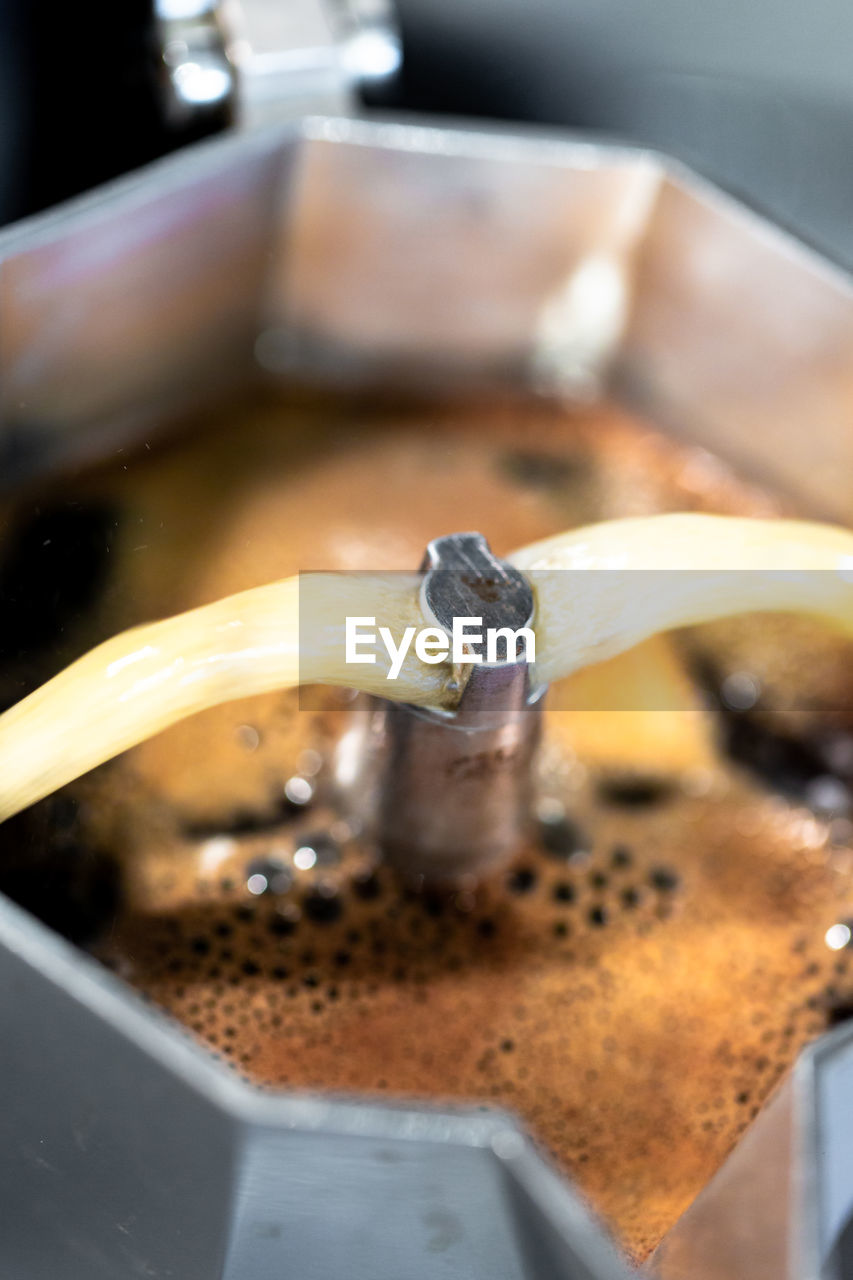 close-up, food and drink, coffee, coffee - drink, no people, coffee maker, drink, metal, selective focus, indoors, food, freshness, refreshment, focus on foreground, preparation, motion, household equipment, kitchen utensil, machinery
