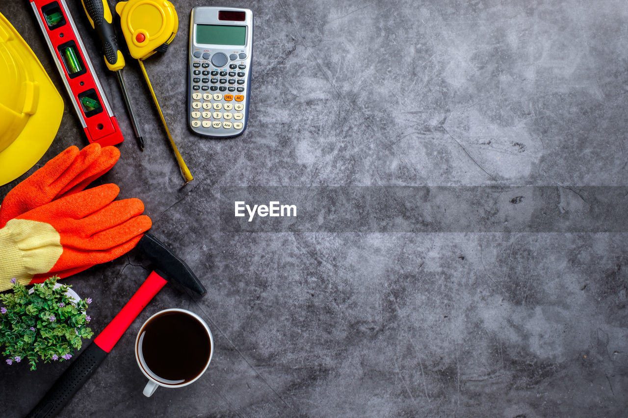 indoors, directly above, no people, still life, cup, high angle view, table, food and drink, equipment, hand tool, gray, orange color, mug, group of objects, tool, work tool, food, container, freshness, refreshment