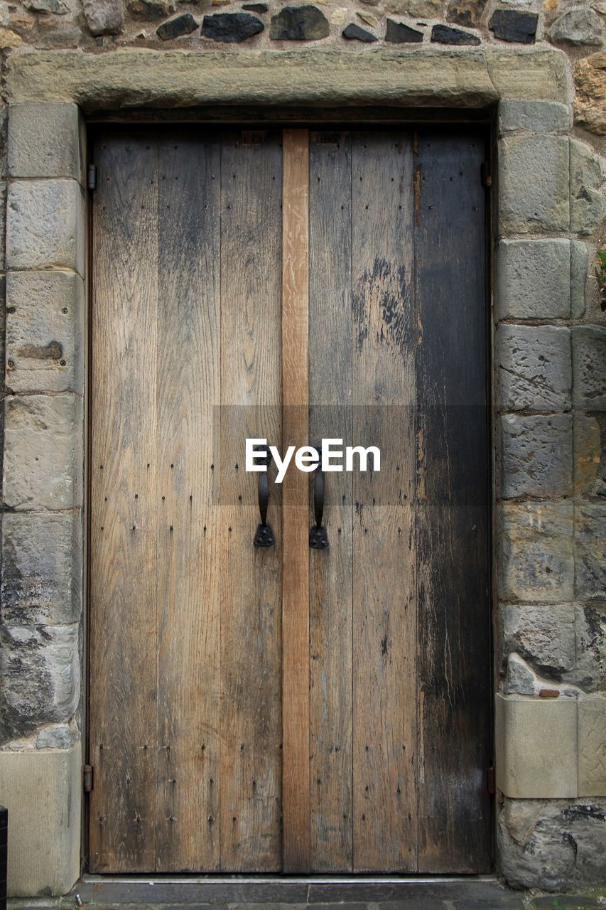 door, wood - material, entrance, closed, safety, built structure, security, architecture, building exterior, no people, protection, building, old, house, day, outdoors, wood, privacy, pattern, front door, garage