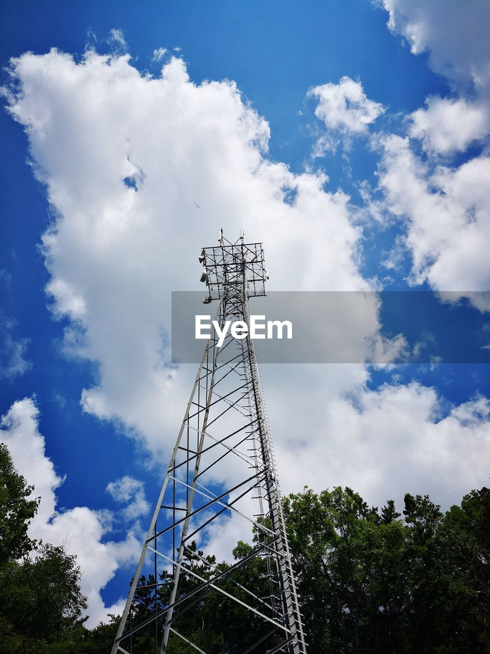 cloud - sky, sky, low angle view, tree, technology, connection, communication, built structure, architecture, nature, plant, no people, day, tall - high, metal, tower, blue, global communications, outdoors, power supply